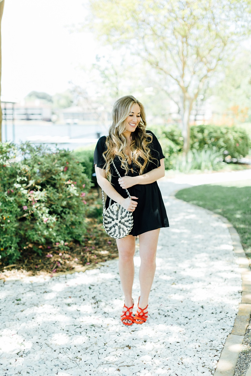 Tie black romper styled by popular fashion blogger, Walking in Memphis in High Heels