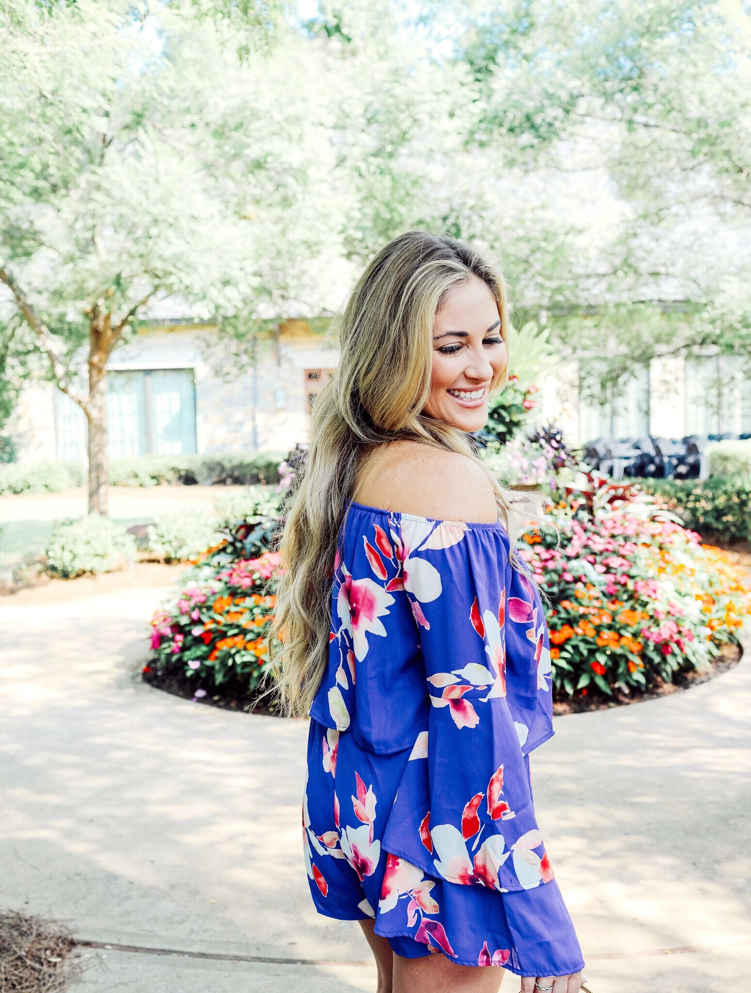 Super Cute Off the Shoulder Floral Romper from the Pink Lily Boutique featured by popular fashion blogger, Walking in Memphis in High Heels