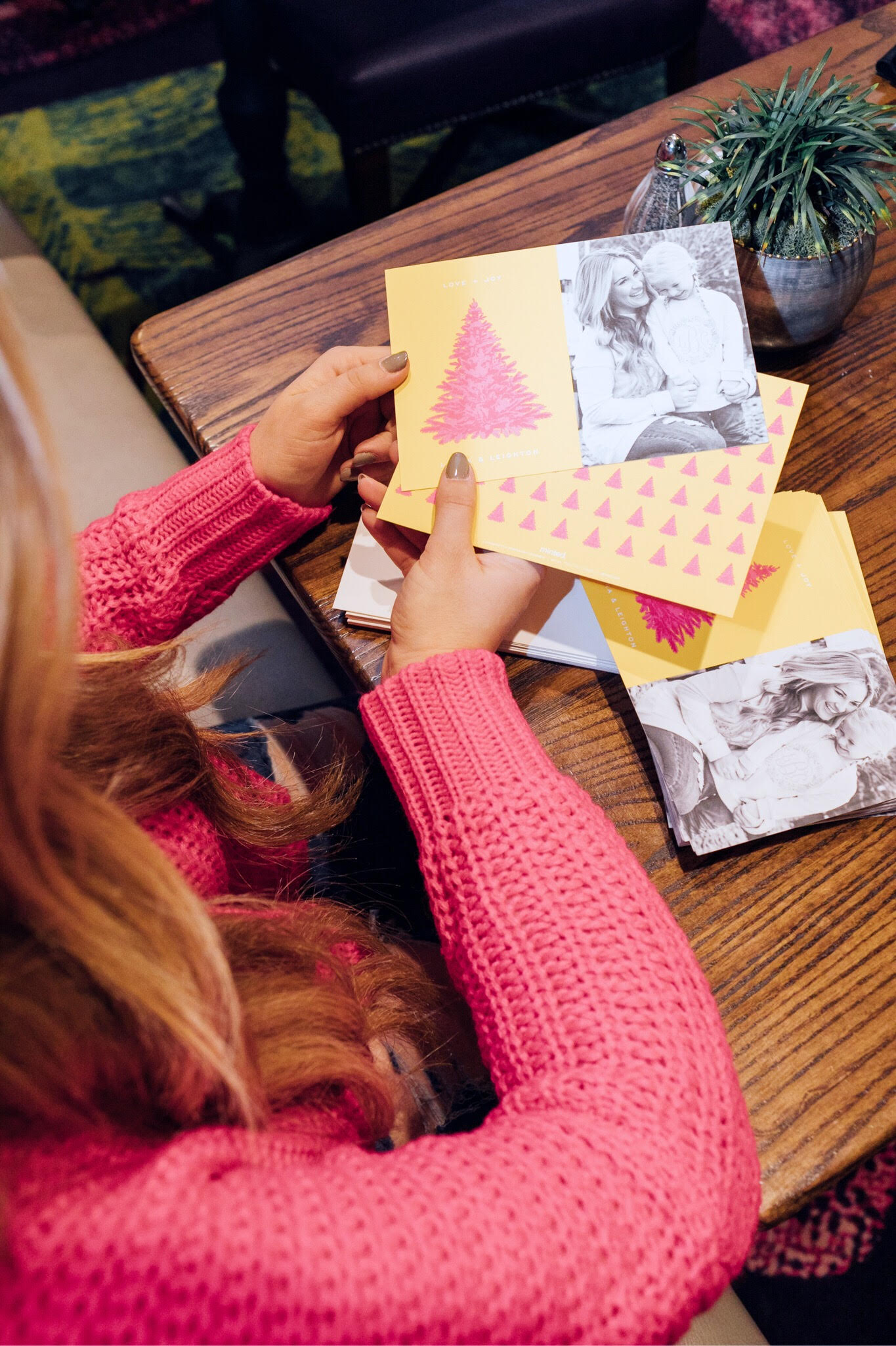 Minted Giveaway for your next Holiday Cards, featured by top lifestyle blog, Walking in Memphis in High Heels: blonde woman sitting smiling and holding her Minted Holiday cards