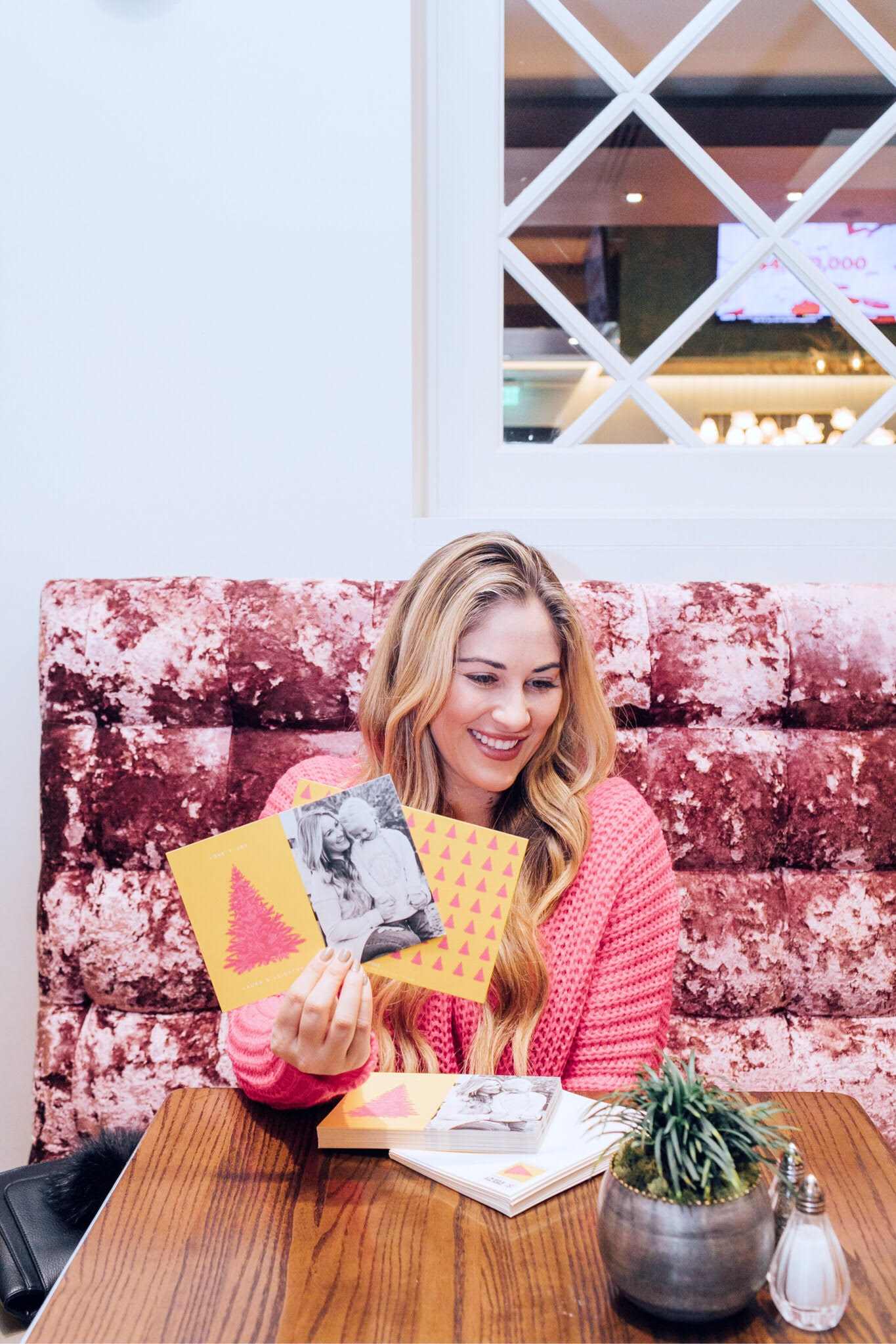 Minted Giveaway for your next Holiday Cards, featured by top lifestyle blog, Walking in Memphis in High Heels: blonde woman sitting smiling and holding her Holiday cards
