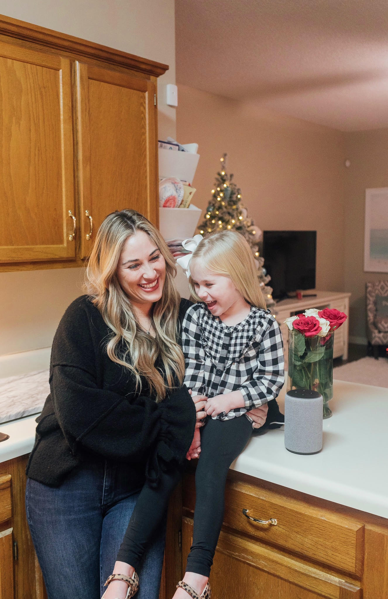 The New Amazon Echo Dot Kids review featured by top US lifestyle blog, Walking in Memphis in High Heels: image of a woman and daughter having fun using the new Amazon Echo Dot Kids.
