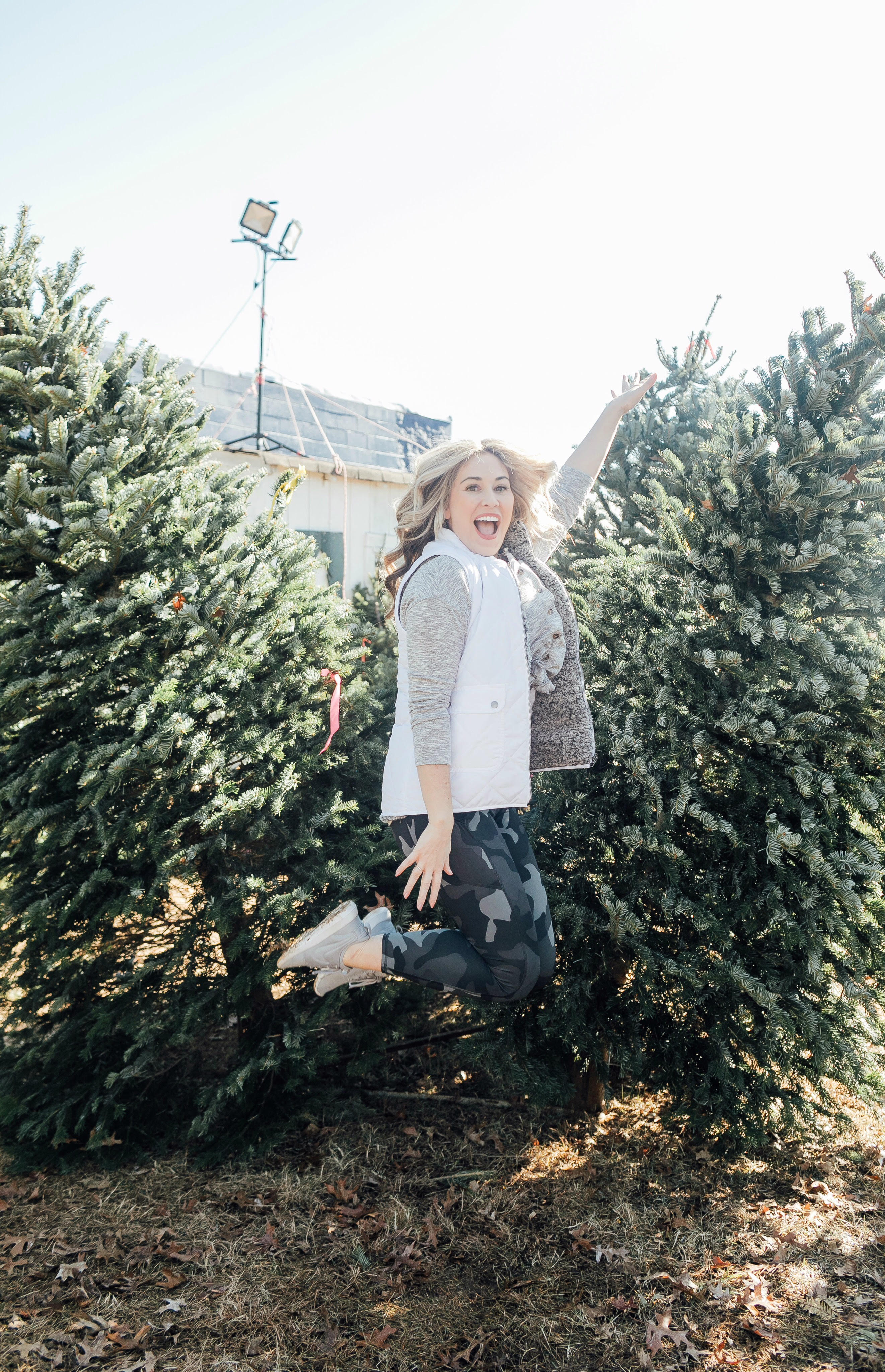 Full Abs Workout featured by top US fitness blog, Walking in Memphis in High Heels, as part of their Holiday Honey Hustle Challenge: image of a woman working out at a Christmas tree farm