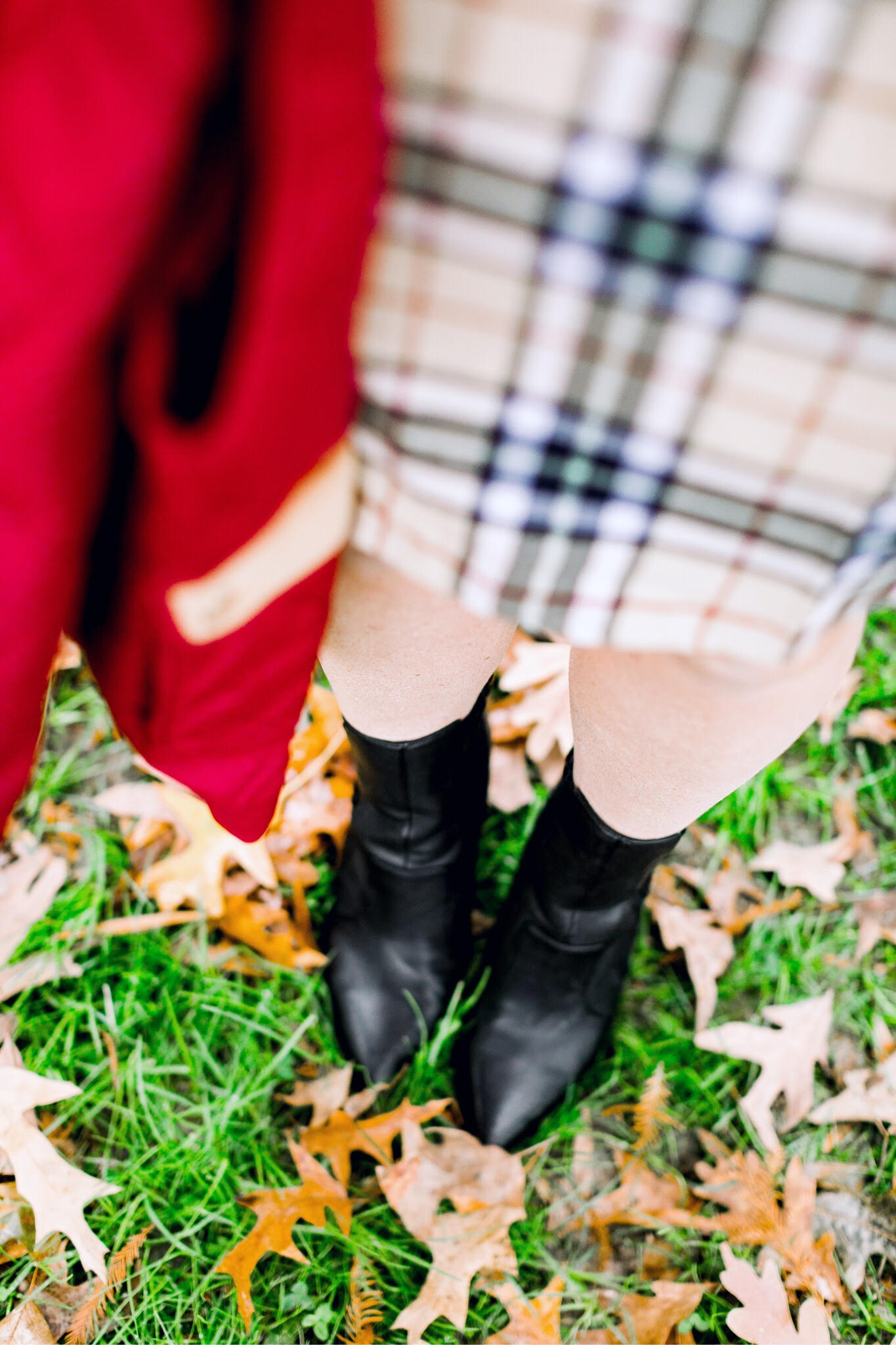 Cute Vests to layer in the Winter, featured by top US fashion blog, Walking in Memphis in High Heels: image of a woman wearing a Lauren James plaid dress, a Lauren James red vest, Sole Society black booties and an ASOS double pom pom beanie