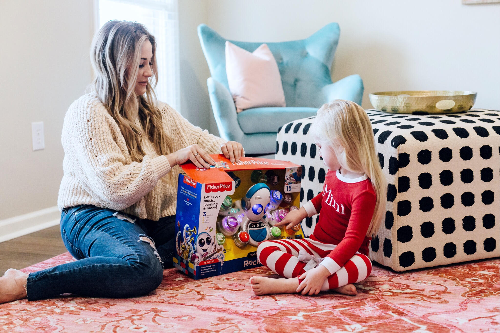 Top 10 Best Toys for Toddlers to Buy this Christmas featured by top US lifestyle blog, Walking in Memphis in High Heels: image of a mom and daughter duo playing with holiday toys