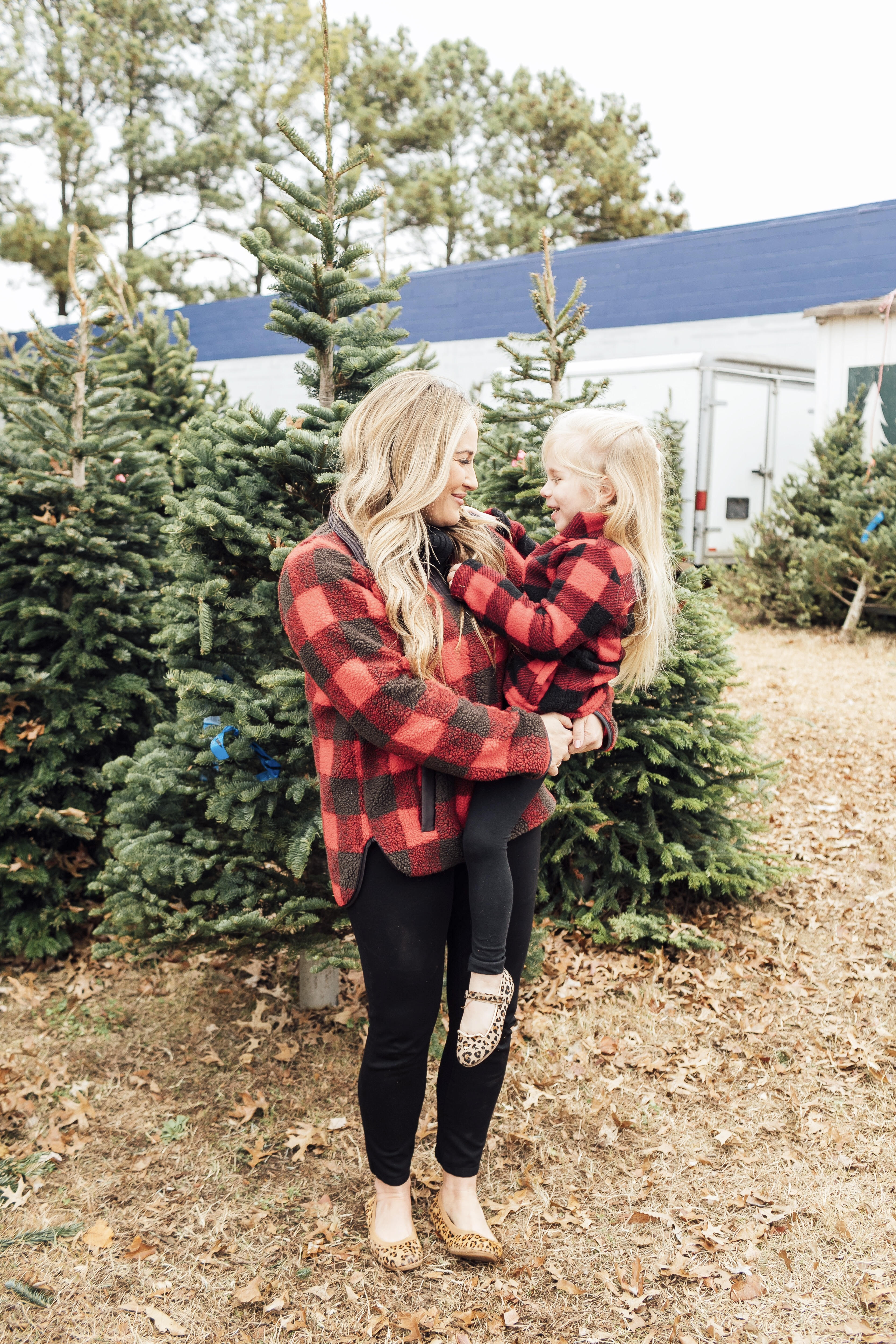 Merry Christmas Wishes featured by top US lifestyle blog, Walking in Memphis in High Heels: image of a mom and daughter wearing red plaid jackets, black jeans and gold shoes