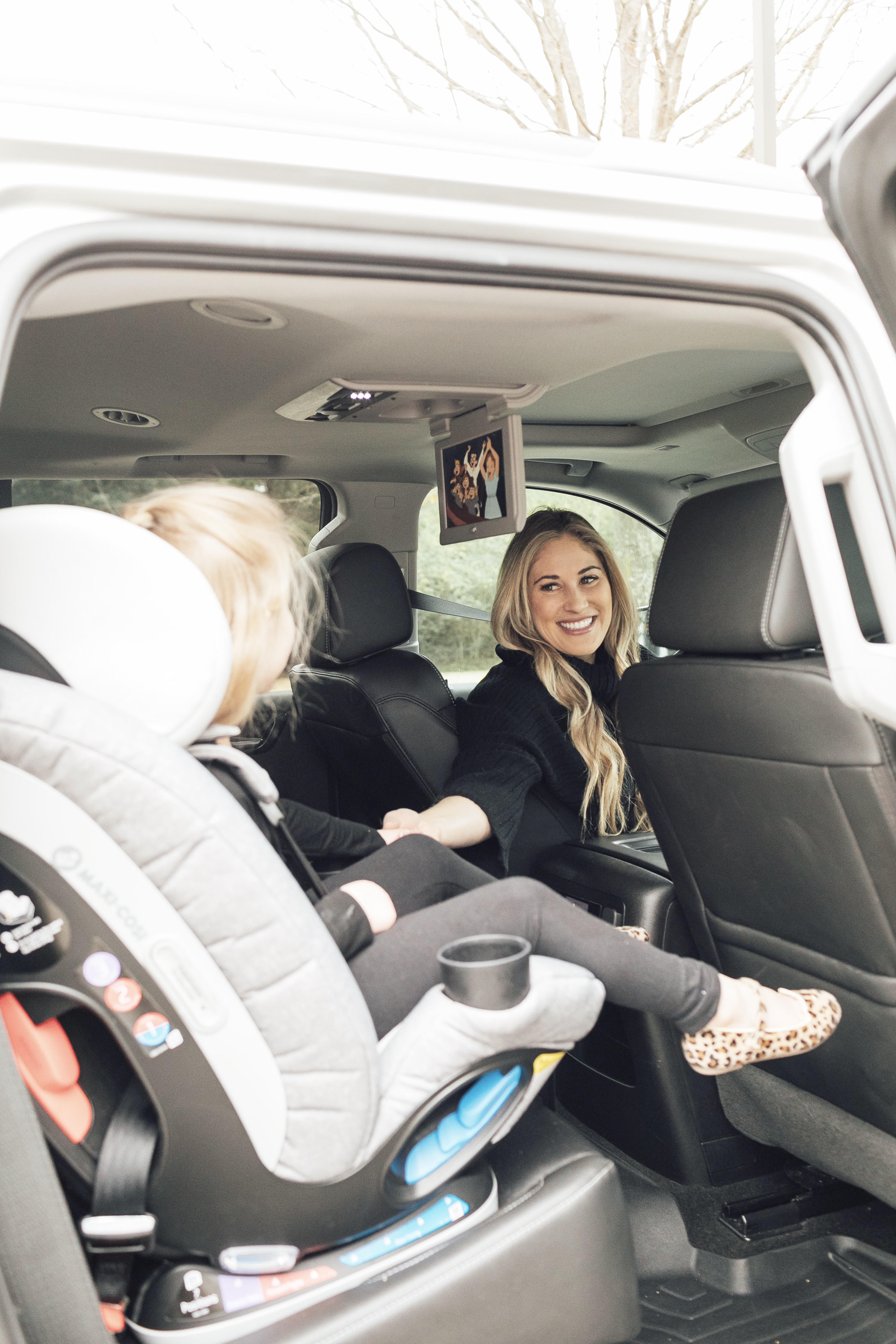 Top US lifestyle blog, Walking in Memphis in High Heels, features some Fun Ideas for Long Road Trips to entertain your children: image of a toddler in her Maxi Cosi car seat