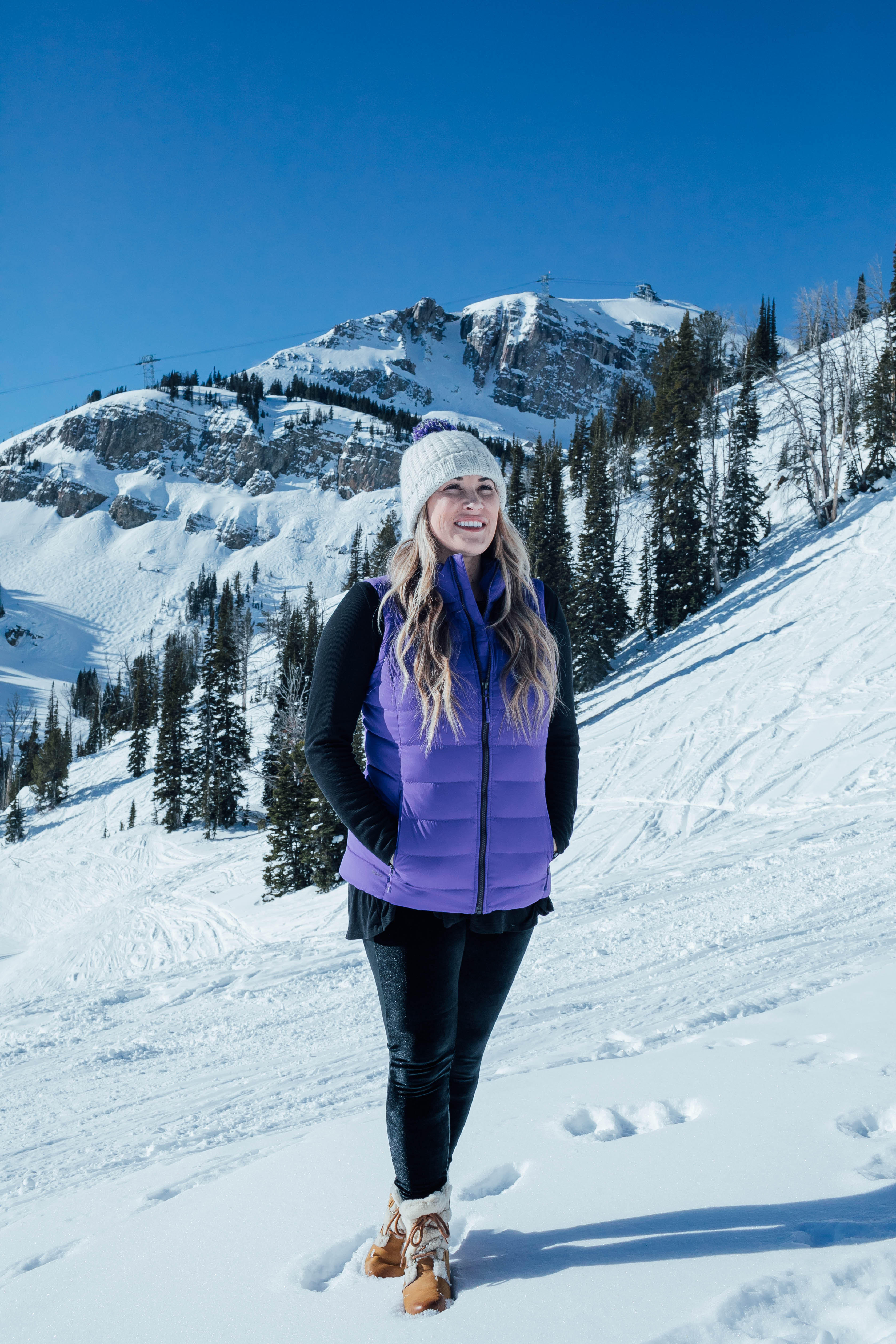 Yummie leggings featured by top US fashion blog, Walking in Memphis in High Heels: image of a woman at a mountain resort wearing Yummie shaping leggings, BP pocket tee, The North Face vest, The North Face pompom beanie hat and Sorel wedge boots