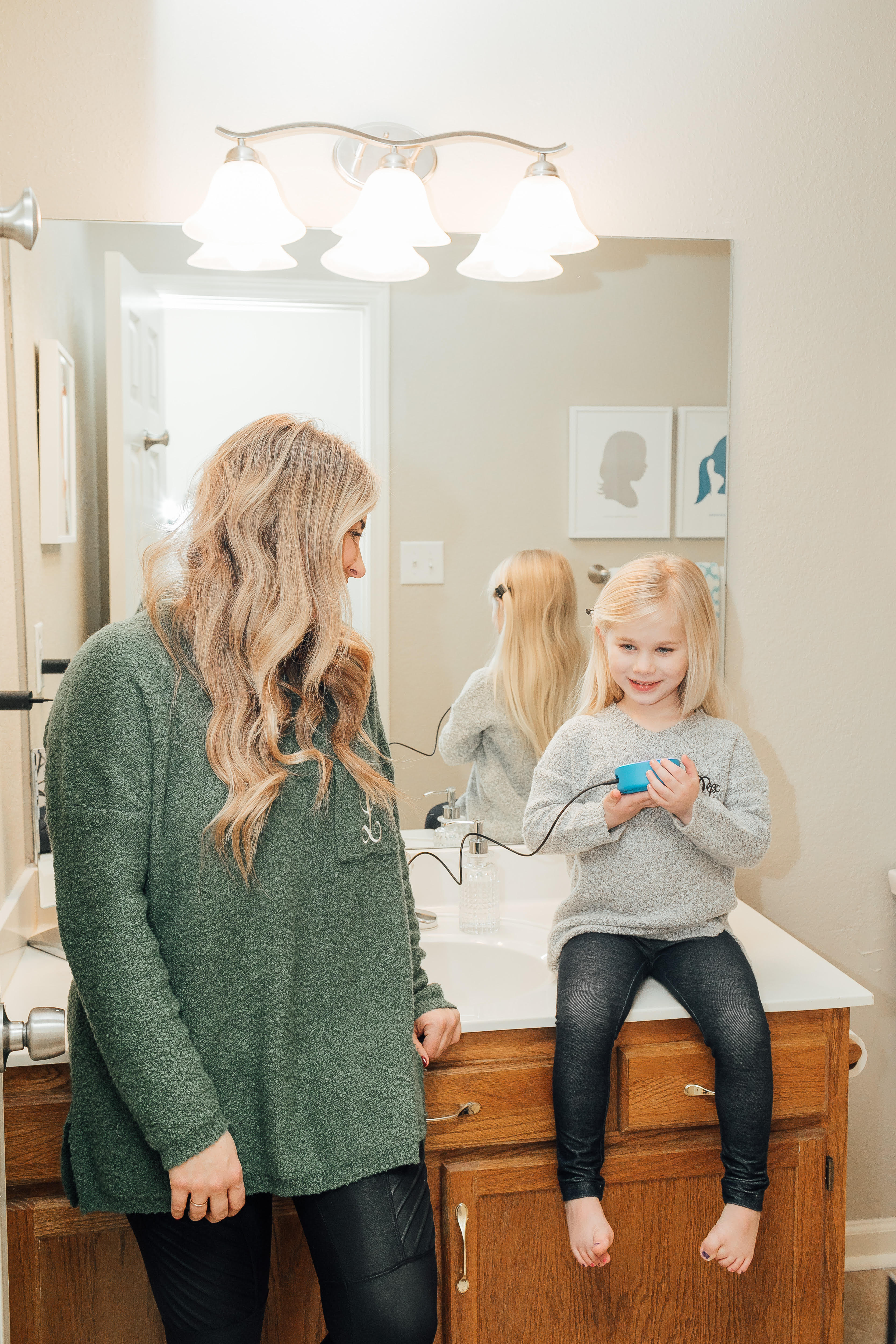 How to Use Amazon Alexa featured by top US lifestyle blog Walking in Memphis in High Heels; Image of a mother with her daughter smiling.
