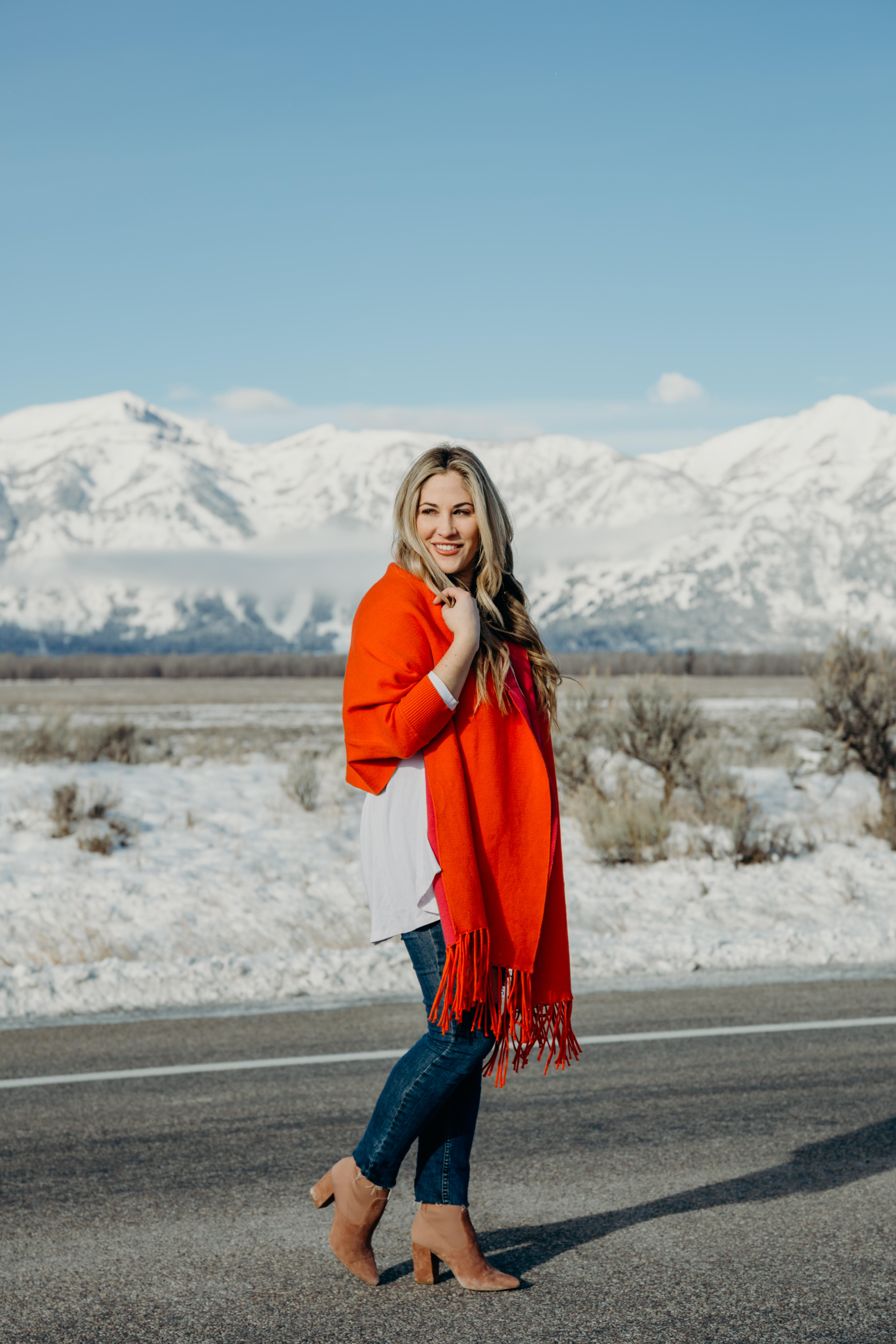 Bright Clothing for Winter featured by top US fashion blog, Walking in Memphis in High Heels: image of a woman wearing a reversible travel wrap