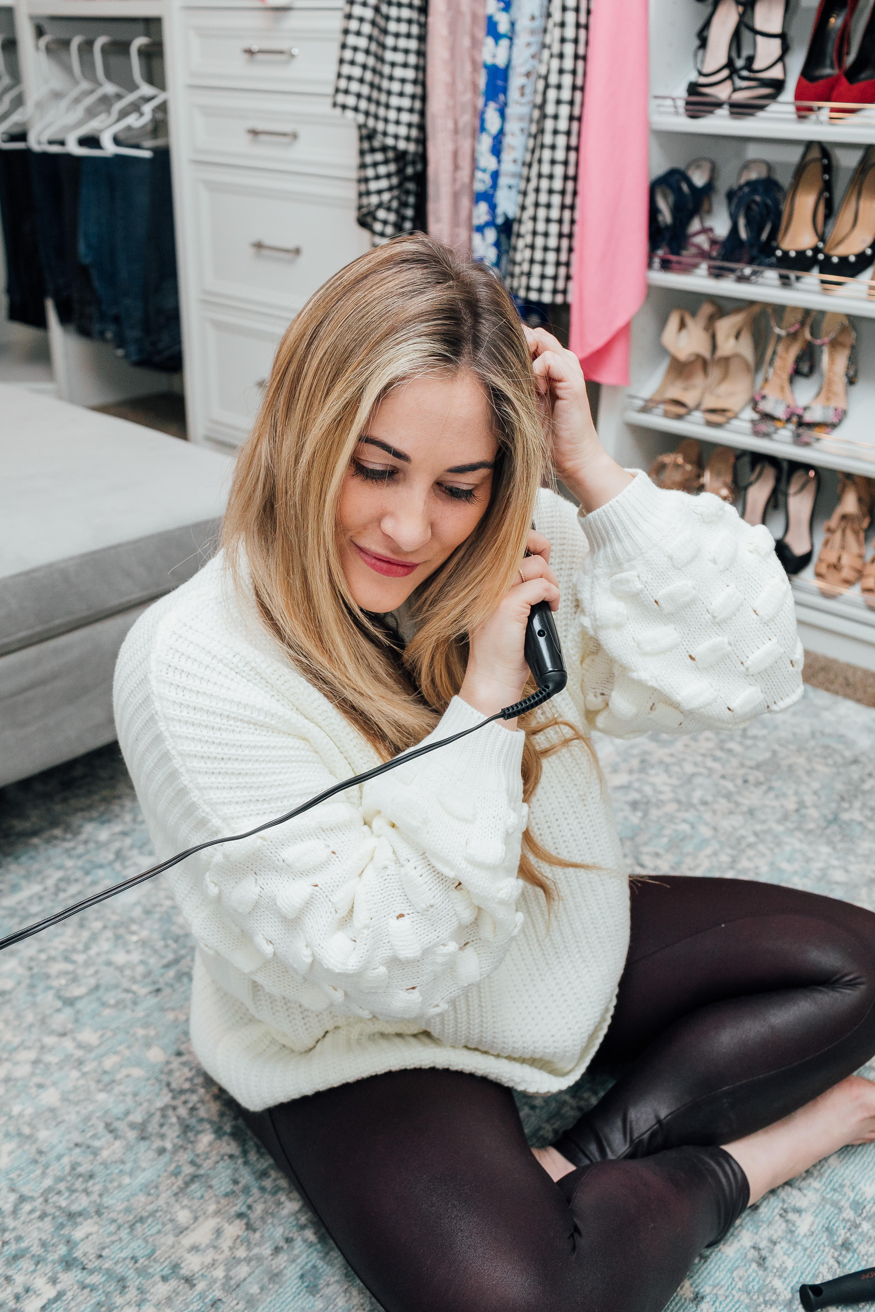 How to Create Beach Waves with a Curling Wand featured by top US beauty blog, Walking in Memphis in High Heels: image of a woman using the Revlon Perfect Heat Curling Iron to create the perfect beach waves