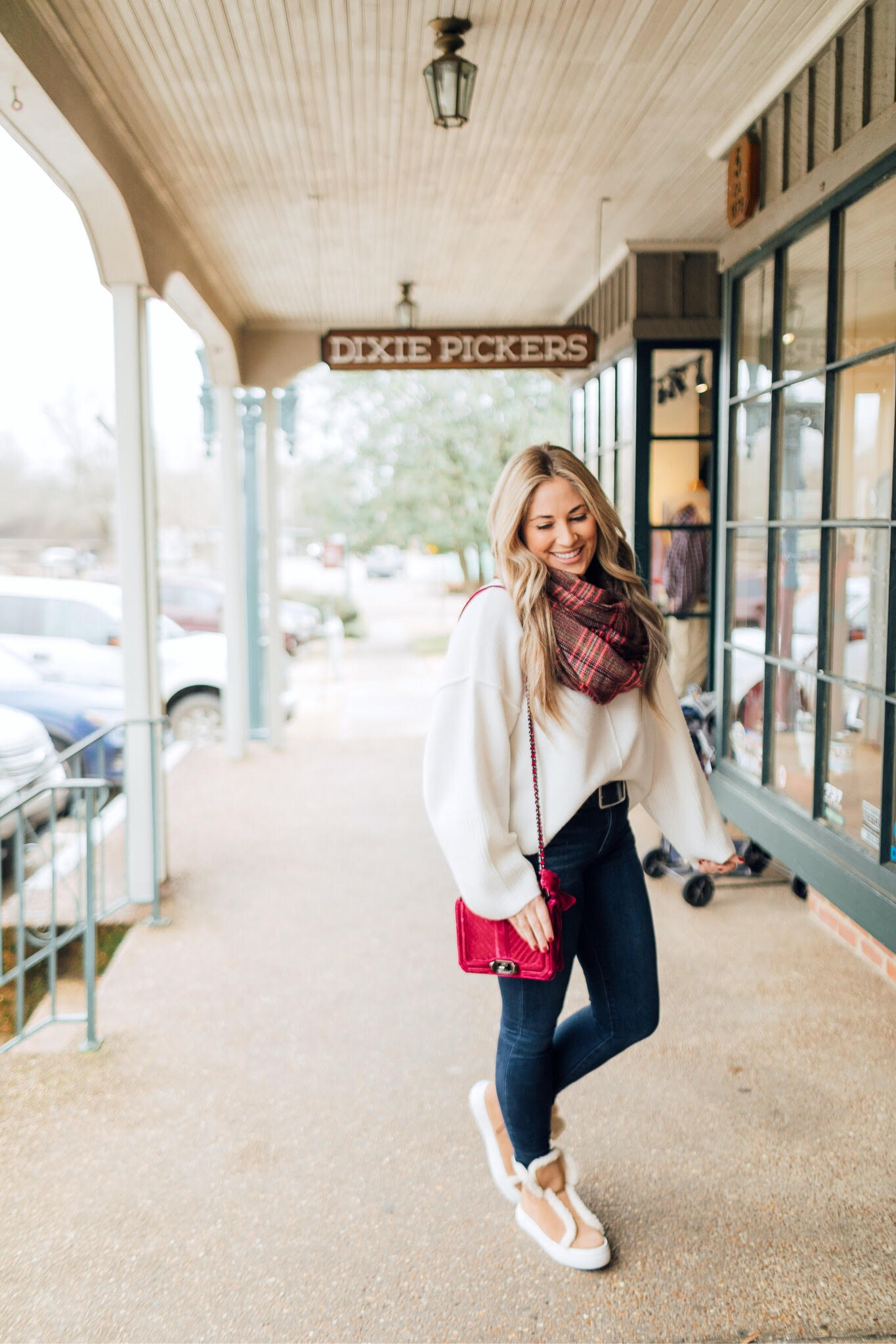 Jack Rogers sherpa sneakers featured by top fashion blog, Walking in Memphis in High Heels: image of a woman wearing sherpa sneakers, Dillards oversized sweater, Nordstrom Rack skinny ankle jeans, Sole Society plaid scarf, and an Evereve pom beanie