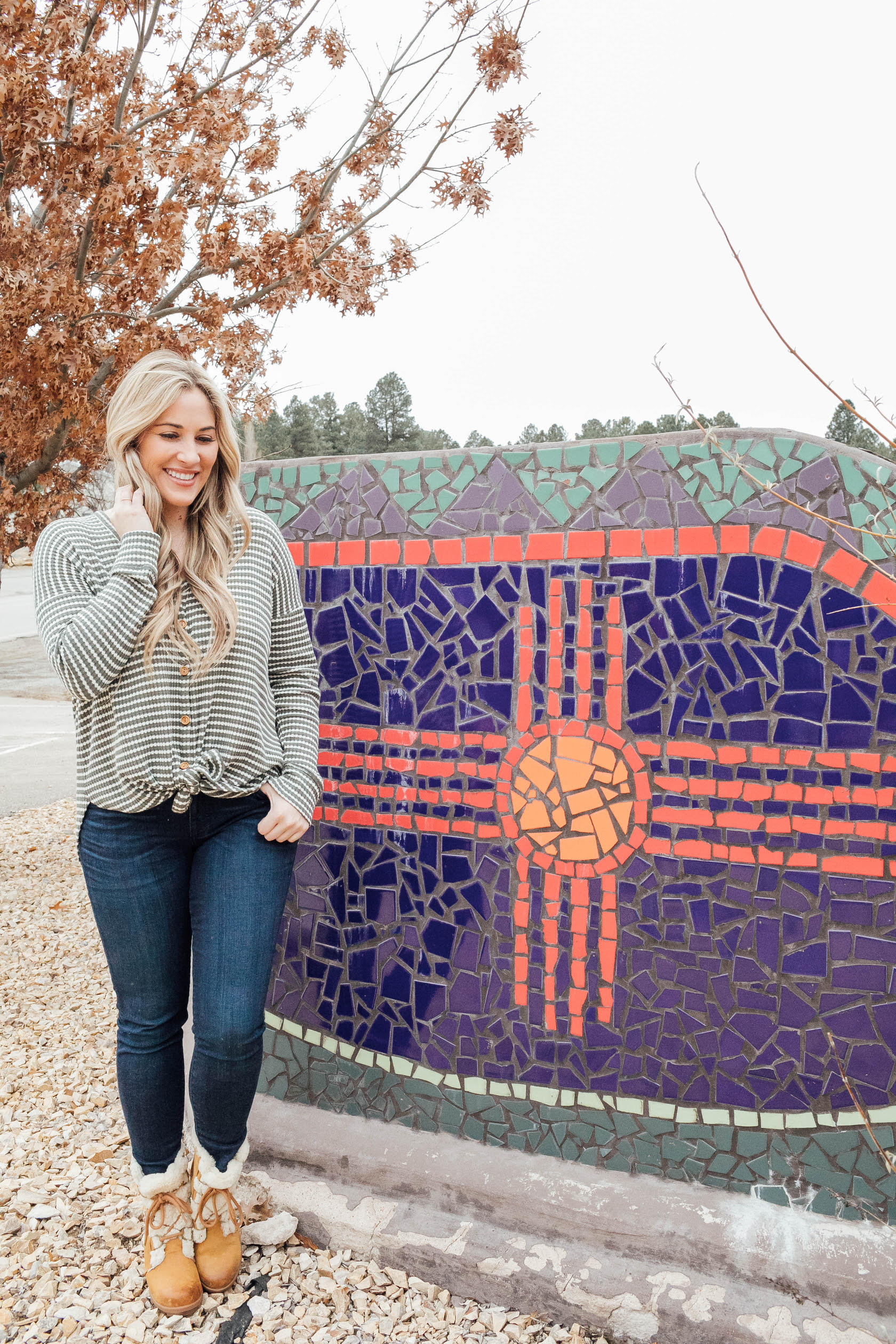Cute winter sherpa boots styled by top US fashion blog, Walking in Memphis in High Heels: image of a woman wearing a Grace and Lace thermal top, Zappos skinny jeans, Patagonia vest, Sorel sherpa boots and Grace and Lace knit pom beanie