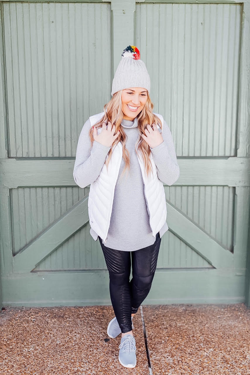 4 ways to style your Spanx Faux Leather Leggings featured by top US fashion blog, Walking in Memphis in High Heels: image of a woman wearing Spanx faux leather leggings, LL Bean Tunic, The North Face vest, Nike Roshe One sneakers