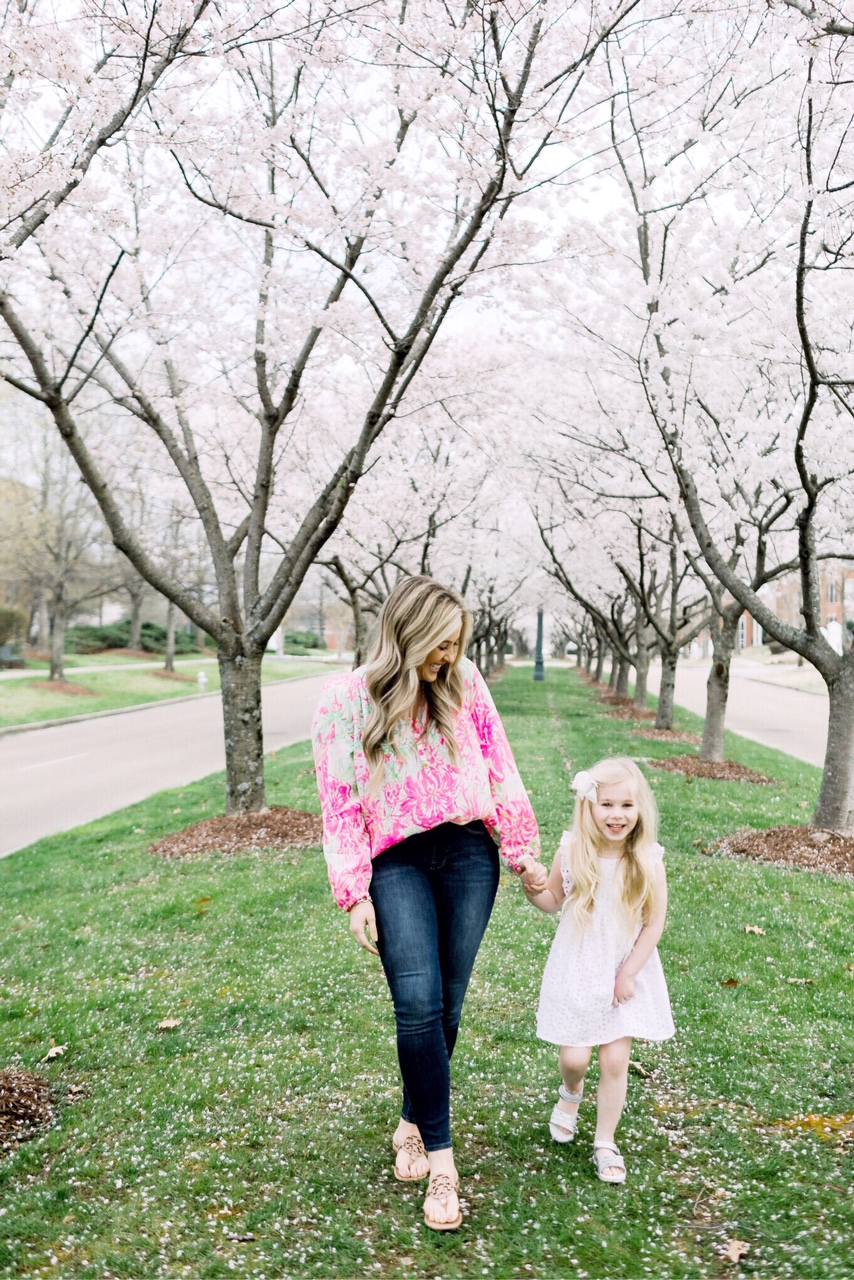 Easter fashion and outfit ideas featured by top US fashion blog, Walking in Memphis in High Heels: image of a woman wearing a Lilly Pulitzer silk top, Good American skinny jeans and Tory Burch sandals and a girl wearing a Lilly Pulitzer eyelet dress and Pediped silver sandals