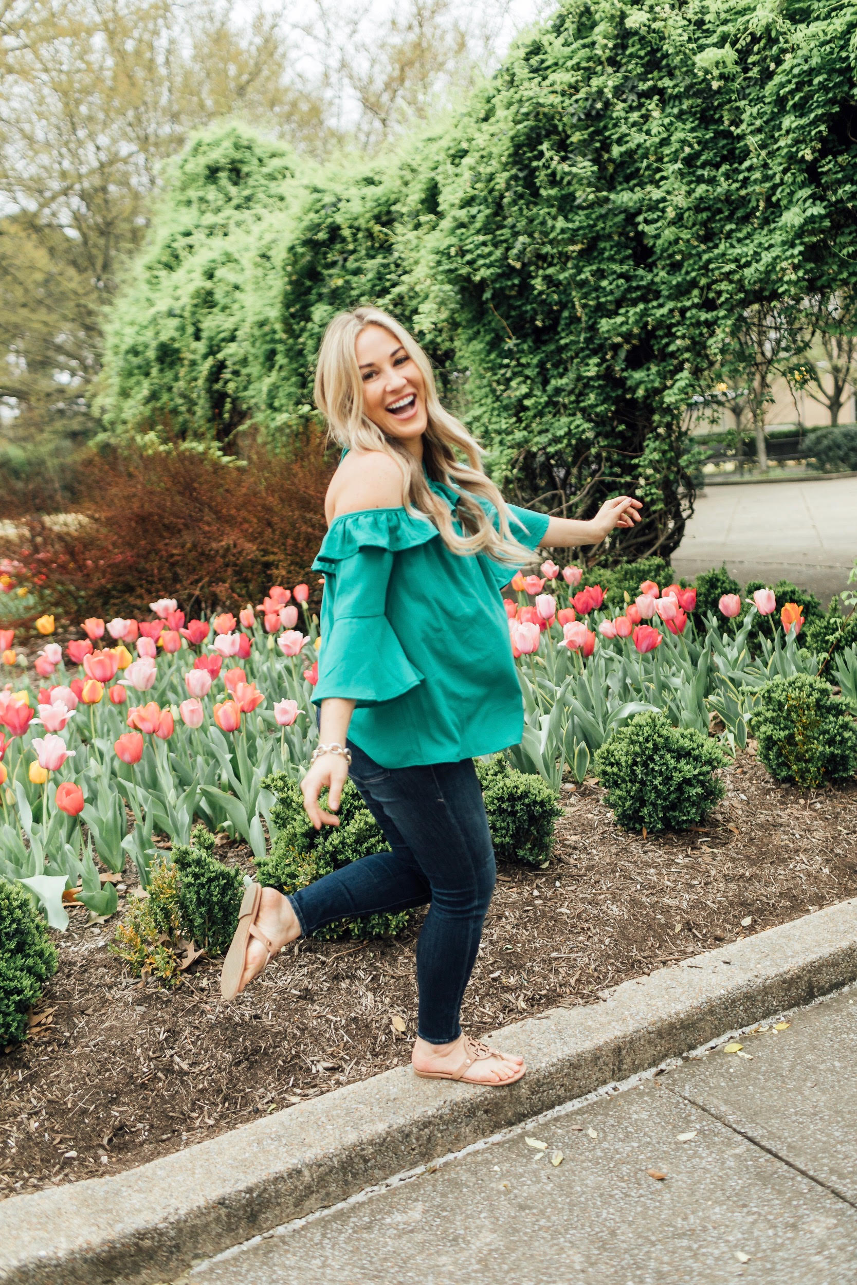 How to Get Cute Family Pictures with Your Child featured by top US life and style blog, Walking in Memphis in High Heels: image of a woman wearing a BB Dakota off the shoulder blouse, Good American skinny jeans, Tory Burch flies flops.