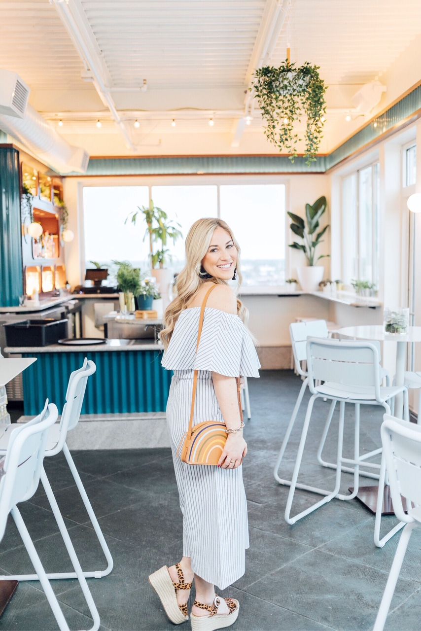 Memorial Day outfits featured by top US fashion blog, Walking in Memphis in High Heels: image of a woman wearing a Morning Lavender striped off the shoulder jumpsuit, Marc Fisher platform espadrille sandals, Madewell rainbow bag