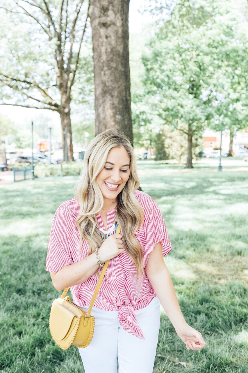 The 5 Most Flattering White Jeans for Summer featured by top US fashion blog, Walking in Memphis in High Heels: image of a woman wearing Chico's no stain flattering white jeans, Chico's striped sleeve top, Chico's colorful bead necklace, and Vince Camuto shorties