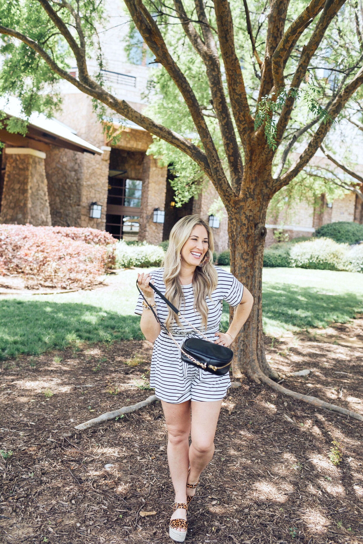 Top 10 Cute Summer Rompers featured by top US fashion blog, Walking in Memphis in High Heels: image of a woman wearing a casual striped summer romper, Marc Fisher leopard espadrille sandals, SUGARFIX hoop earrings
