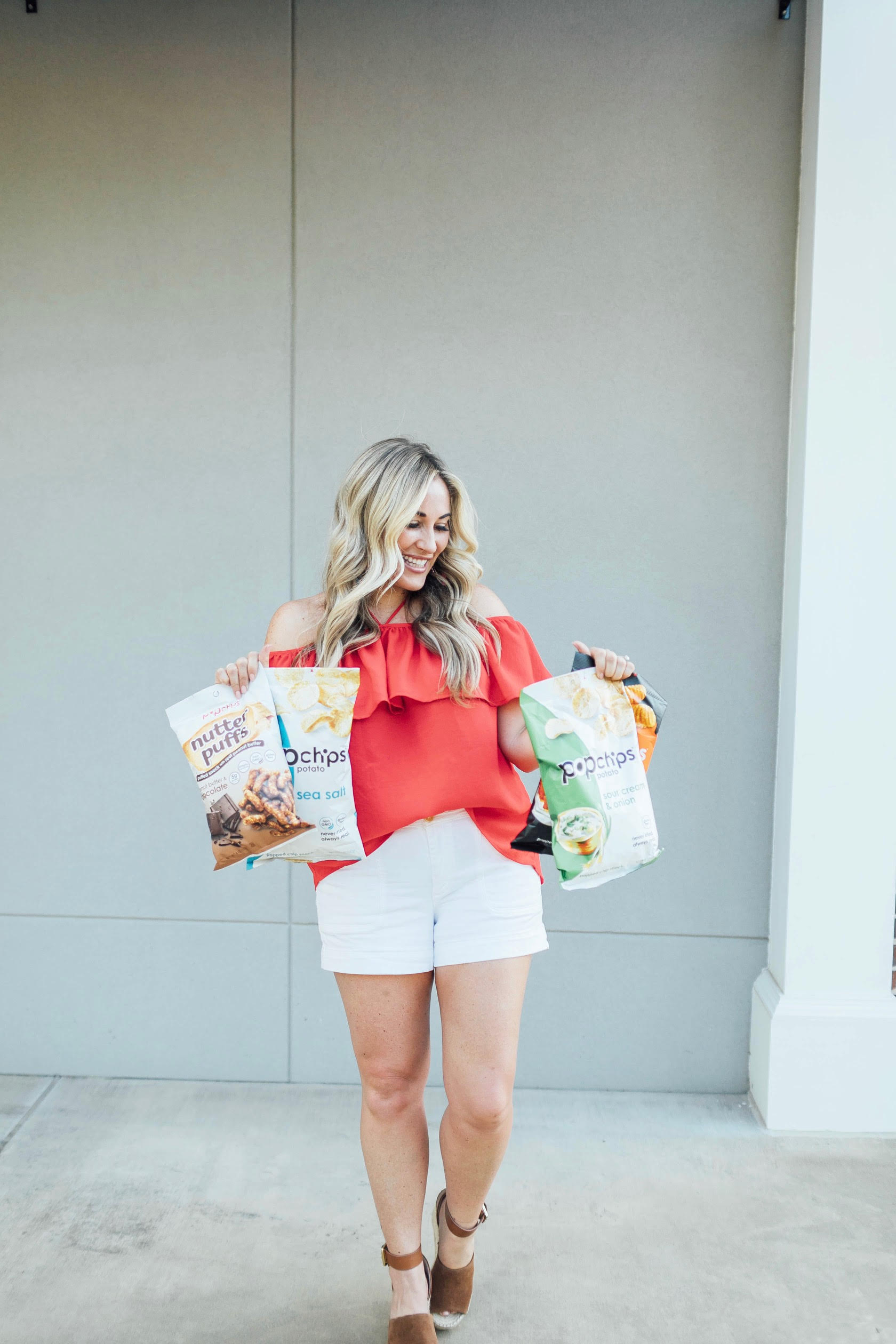 Popchips review: light summer snack featured by top US life and style blog, Walking in Memphis in High Heels: image of a woman a Jack by BB Dakota Off the Shoulder top, Anthropologie belted shorts, BAUBLEBAR raffia statement earrings, and March Fisher ankle strap espadrille sandals