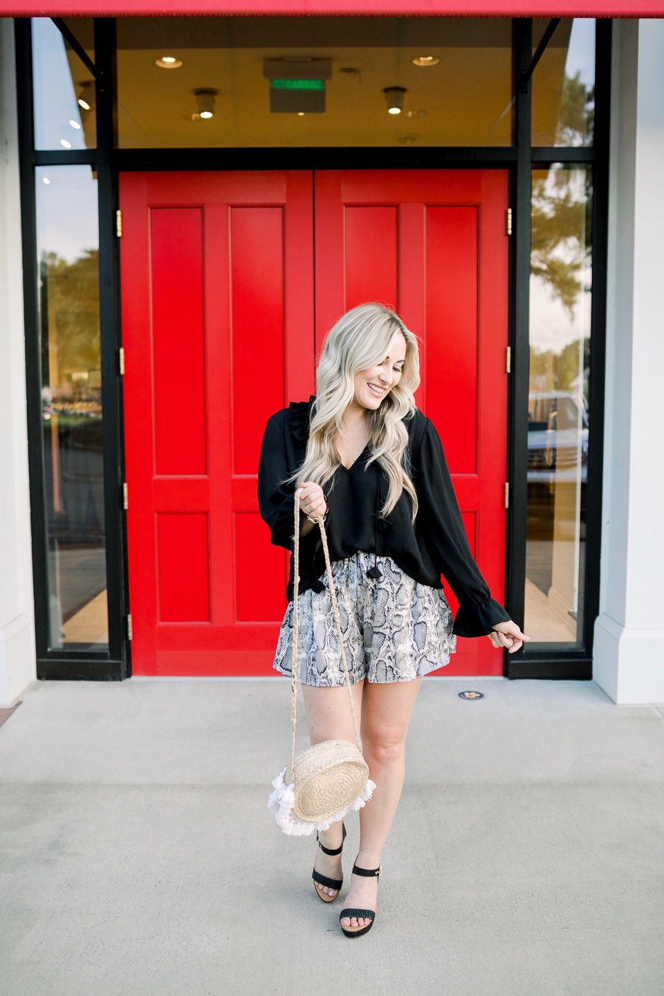 Cute woven sandals featured by top US fashion blog, Walking in Memphis in High Heels: image of a woman wearing Dressing Room Boutique woven sandals, Dressing Room Boutique snakeskin shorts, and a Dillard's ruffle blouse.