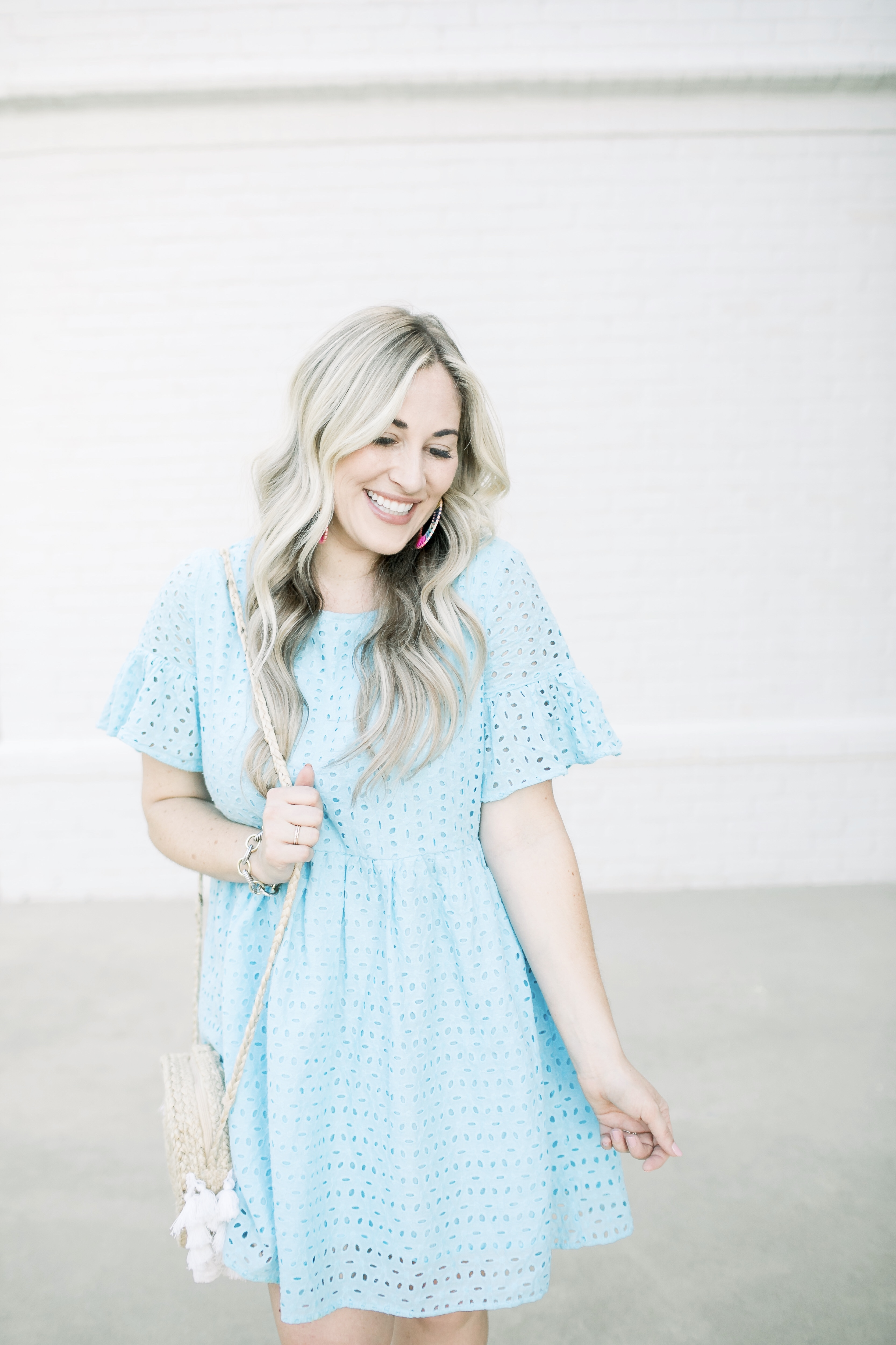 Summer style casual look featured by top US fashion blog, Walking in Memphis in High Heels: image of a woman wearing a SheIn eyelet dress, Marc Fisher espadrille wedge sandals, and BAUBLEBAR raffia statement earrings.