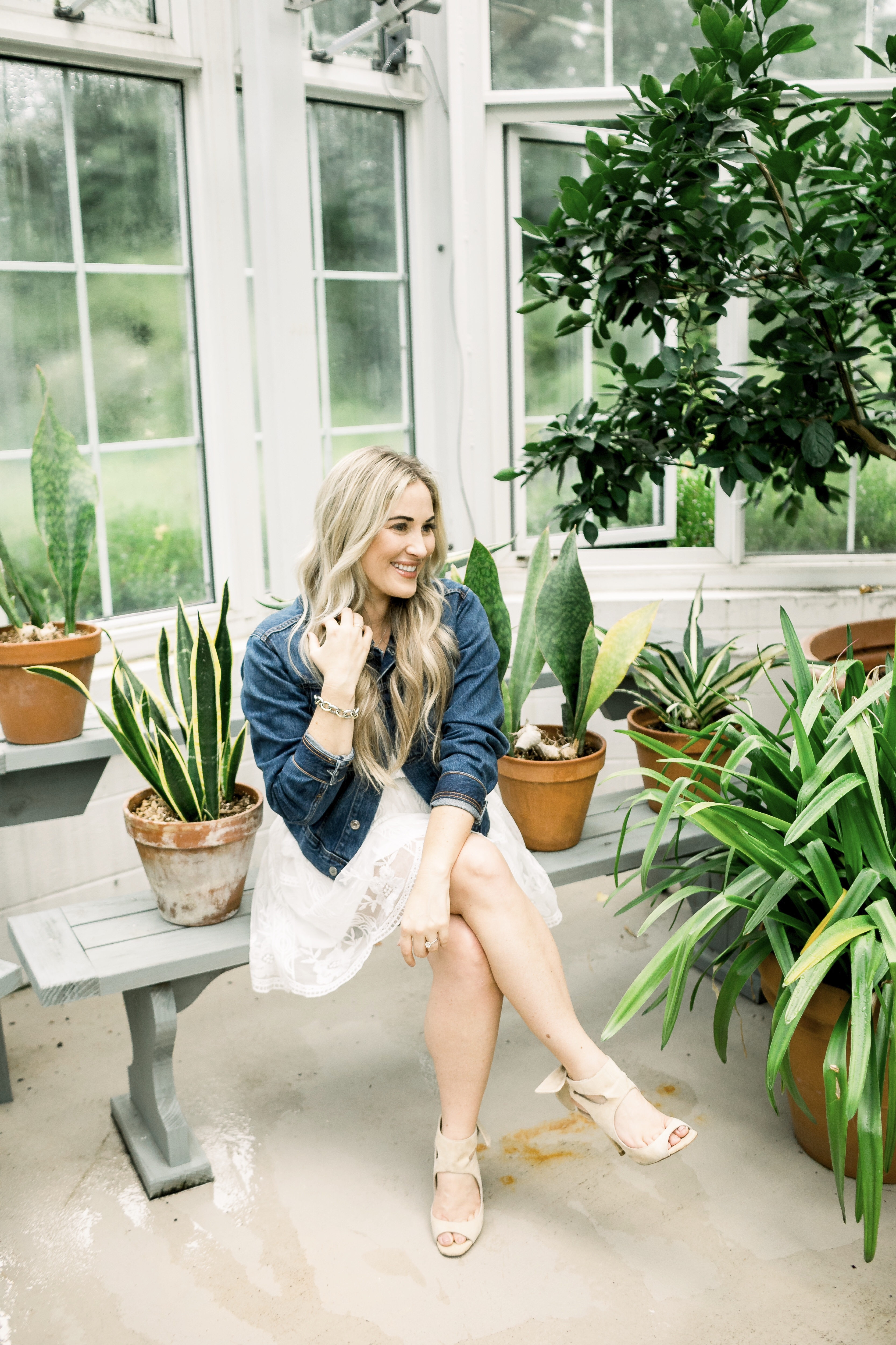 Summer denim look styled by top US fashion blog, Walking in Memphis in High Heels: image of a woman wearing a SheIn embroidered dress and Everyone denim jacket.