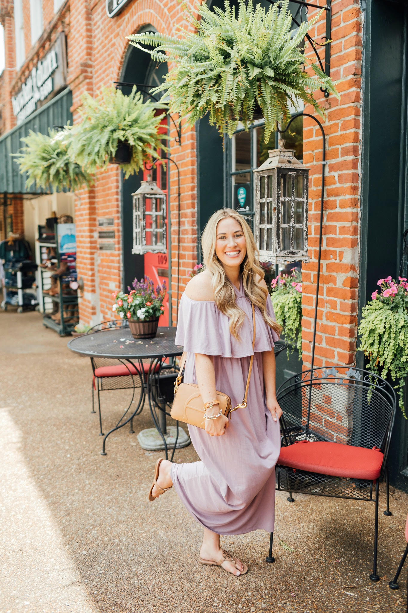 Cute maxi dresses to wear from Summer to Fall featured by top US fashion blog, Walking in Memphis in High Heels: image of a woman wearing a PinkBlush off the shoulder maxi dress, and Tory Burch Miller flip flops.