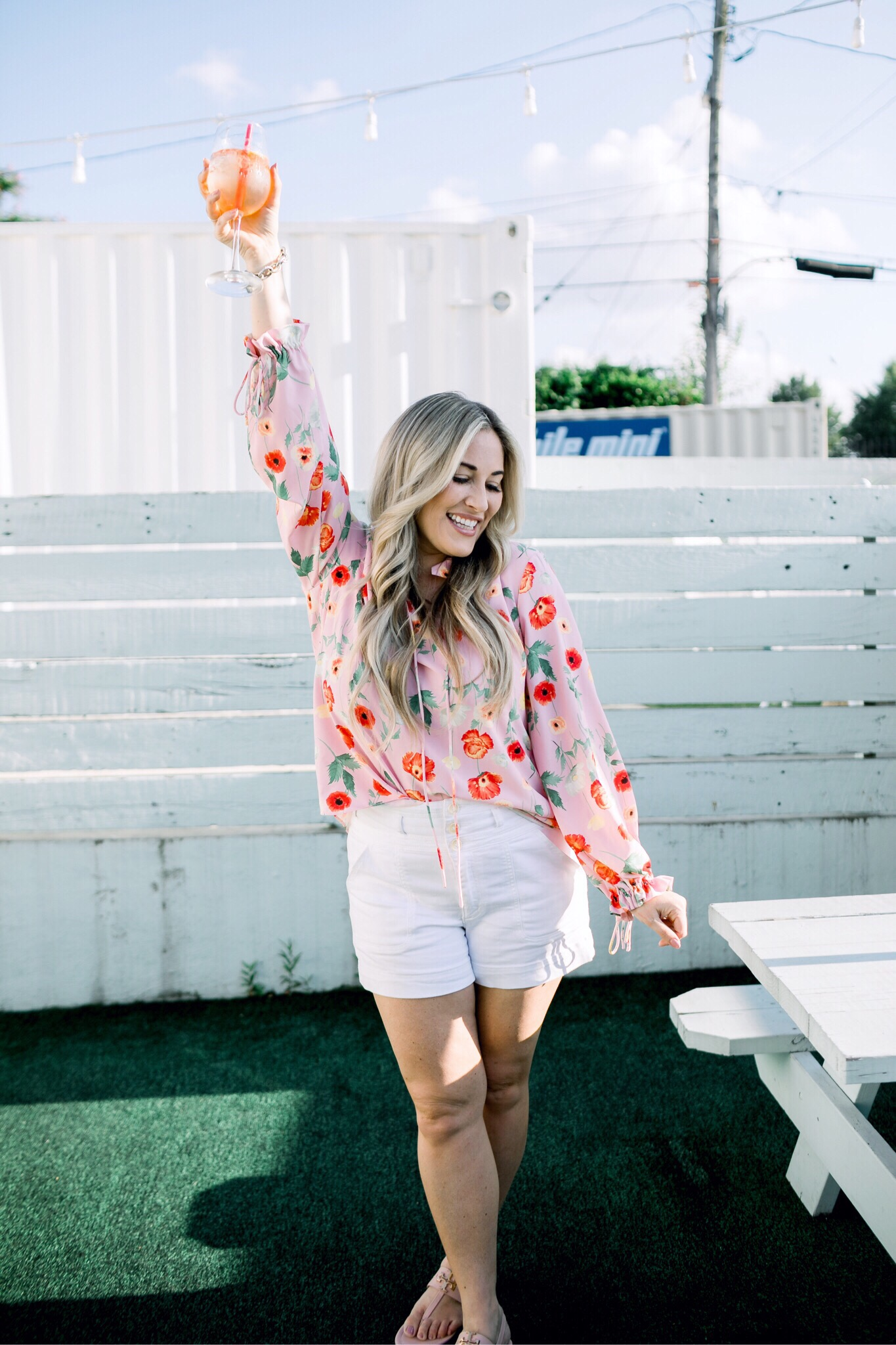 Bright summer colors fashion featured by top US fashion blog, Walking in Memphis in High Heels: image of a woman wearing a Gibson & Latimer floral shirt, Anthropologie high waisted white denim shorts, Tory Burch Miller flip flops and a David Yurman bracelet