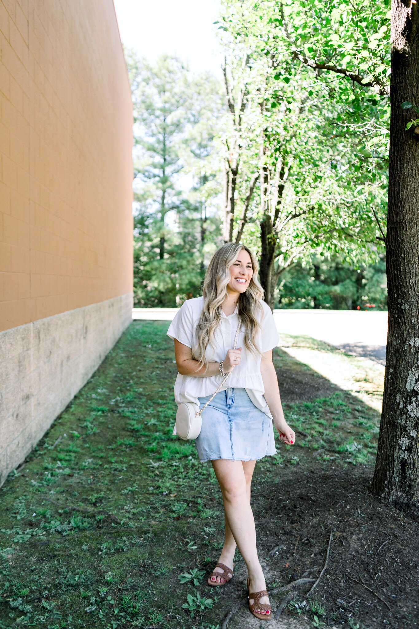 Cute college outfit from Walmart styled by top US fashion blog, Walking in Memphis in High Heels: image of a woman wearing a Time and Tru top, Sofia Jeans by Sofia Vergara denim skirt, and Sam Edelman sandals.
