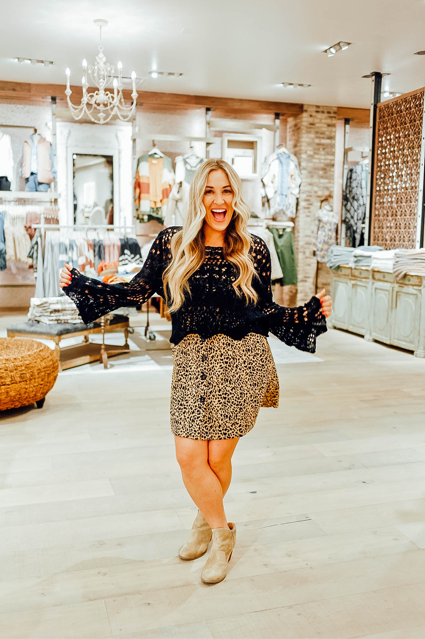 Cute Fall Sweaters featured by top US fashion blog, Walking in Memphis in High Heels: image of a woman wearing an Altar'd State crochet fall sweater and leopard sleeveless dress.