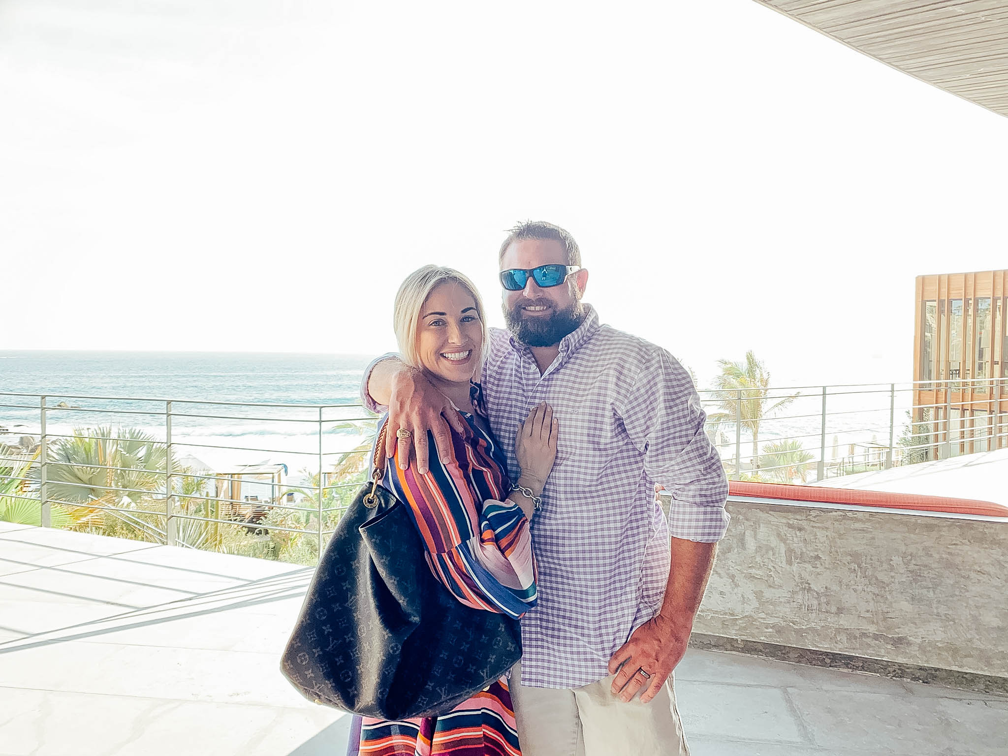 Top 10 Fall Honeymoon Destinations featured by top US travel blog, Walking in Memphis in High Heels: image of a couple in Cabo San Lucas, Mexico