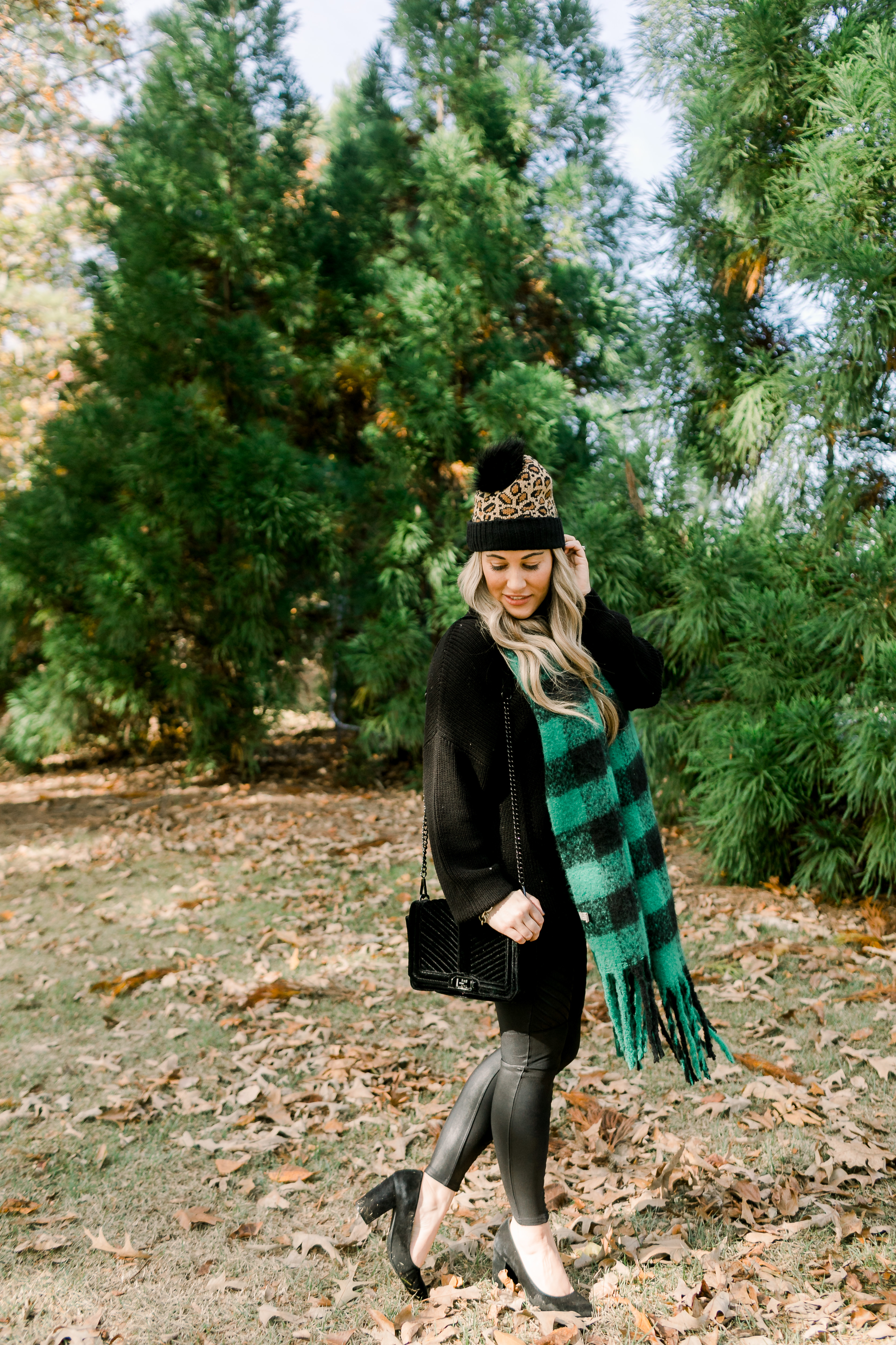 How to Style Leggings with Heels, fashion tips featured by top US fashion blog, Walking in Memphis in High Heels: image of a woman wearing Spanx Moto faux leather leggings and Sam Edelman heeled pumps.