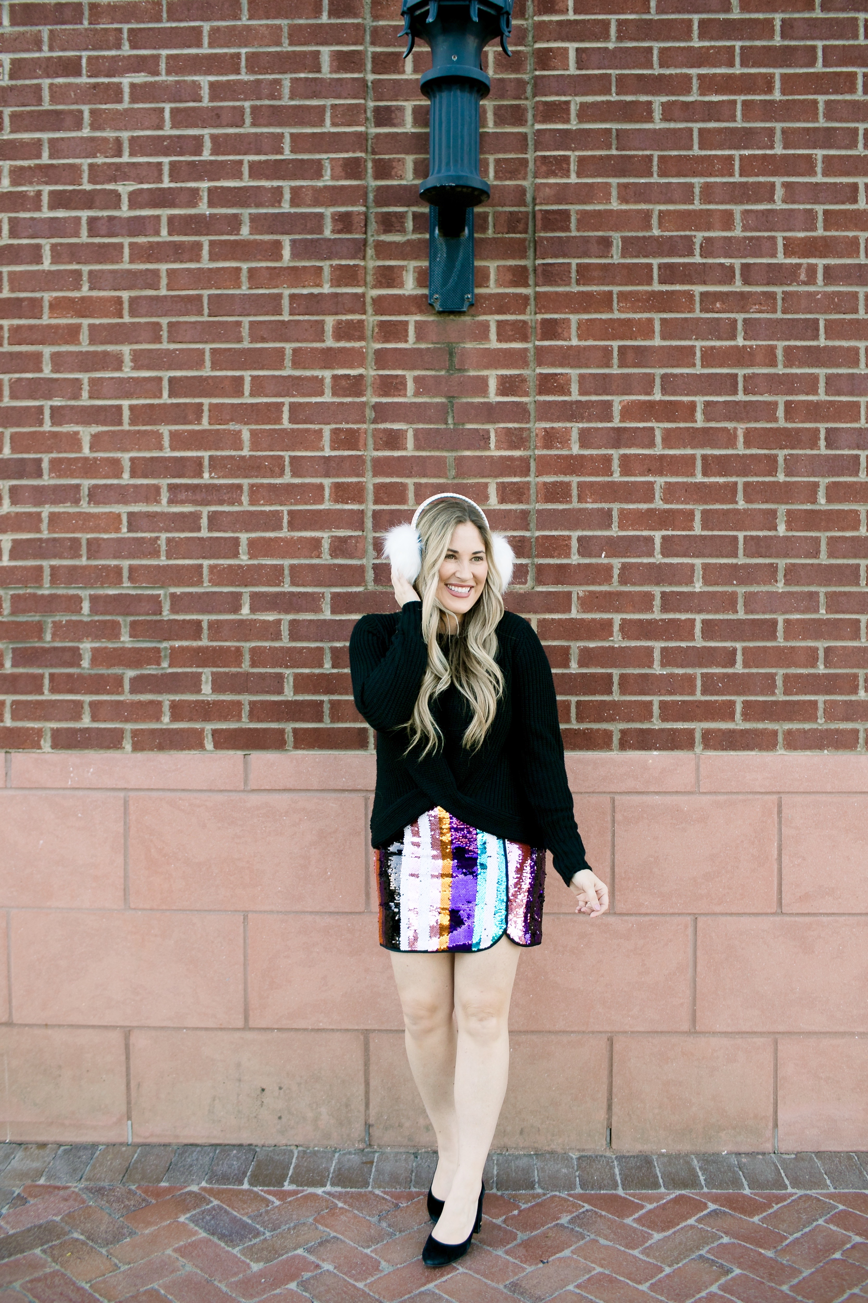 Holiday Style featured by top Memphis fashion blog, Walking in Memphis in High Heels: image of a woman wearing Francesca's sequin mini skirt,  Francesc's sweater, Francesca's furry ear muffs, and San Edelman pumps.