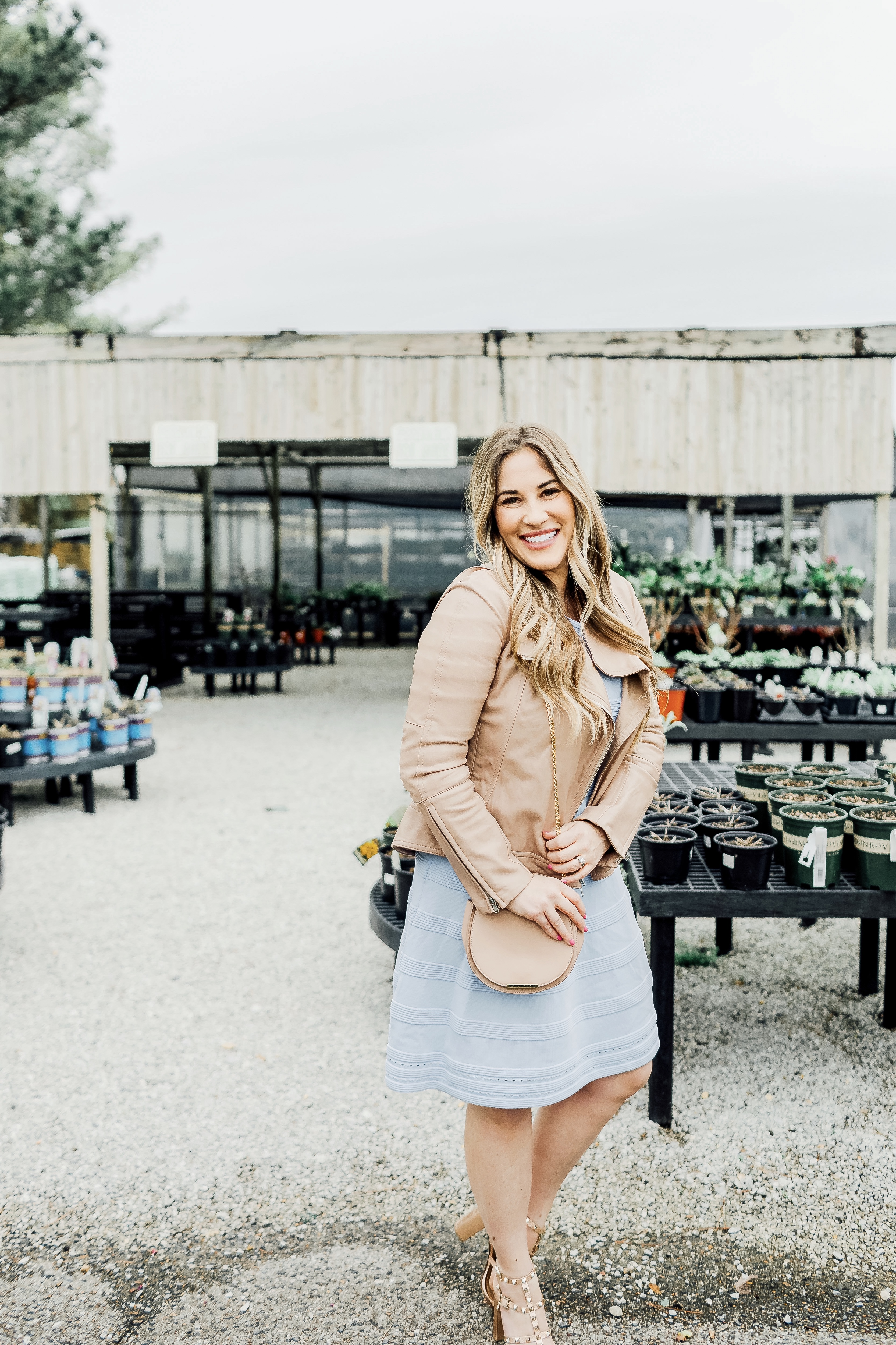 Cute Easter Dresses featured by top Memphis fashion blog, Walking in Memphis in High Heels: image of a woman wearing a pastel blue Eliza J sweater dress.