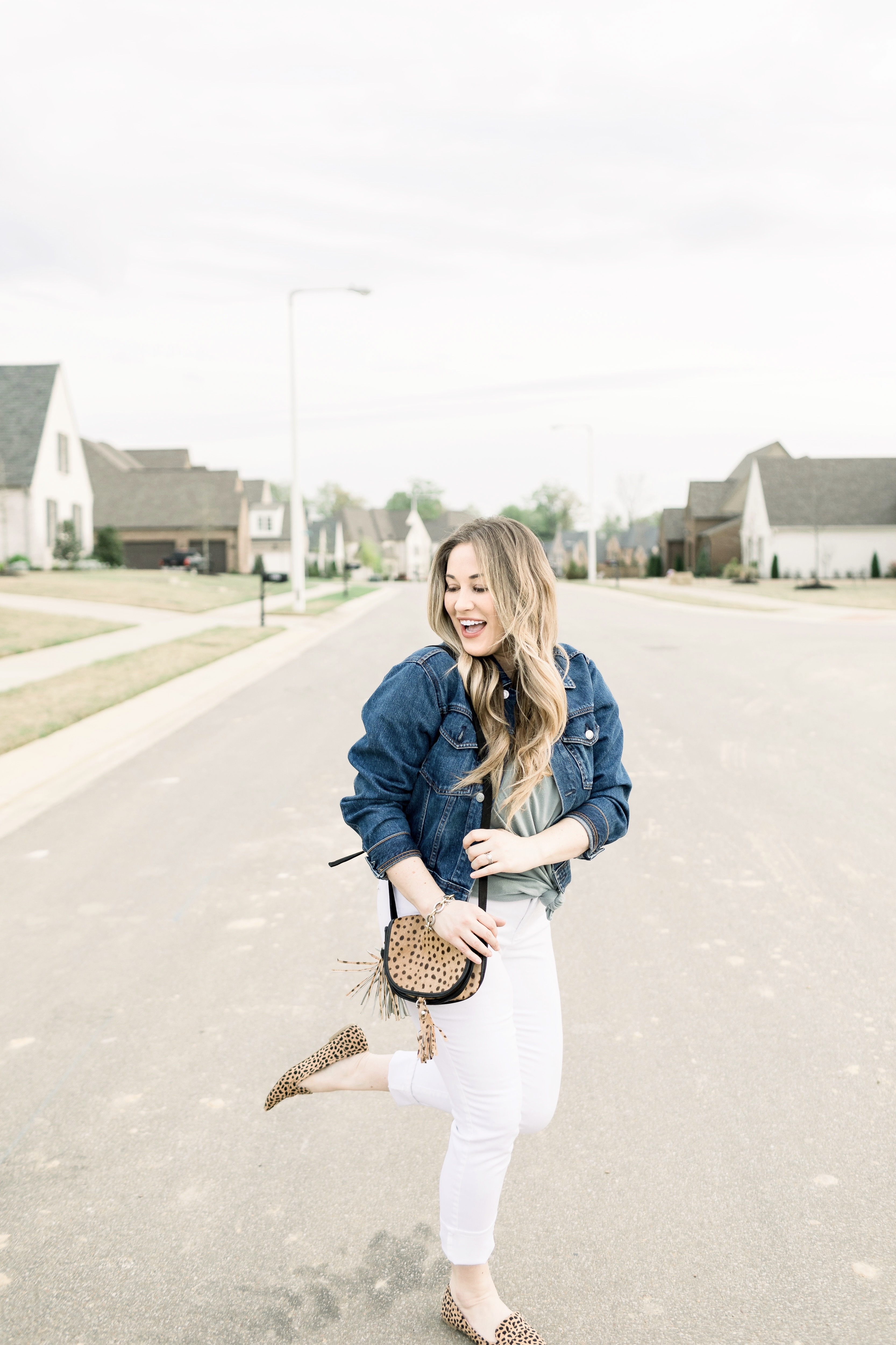 White jeans outfit styled by top Memphis fashion blog, Walking in Memphis in High Heels: image of a woman wearing Chicos white ankle jeans.