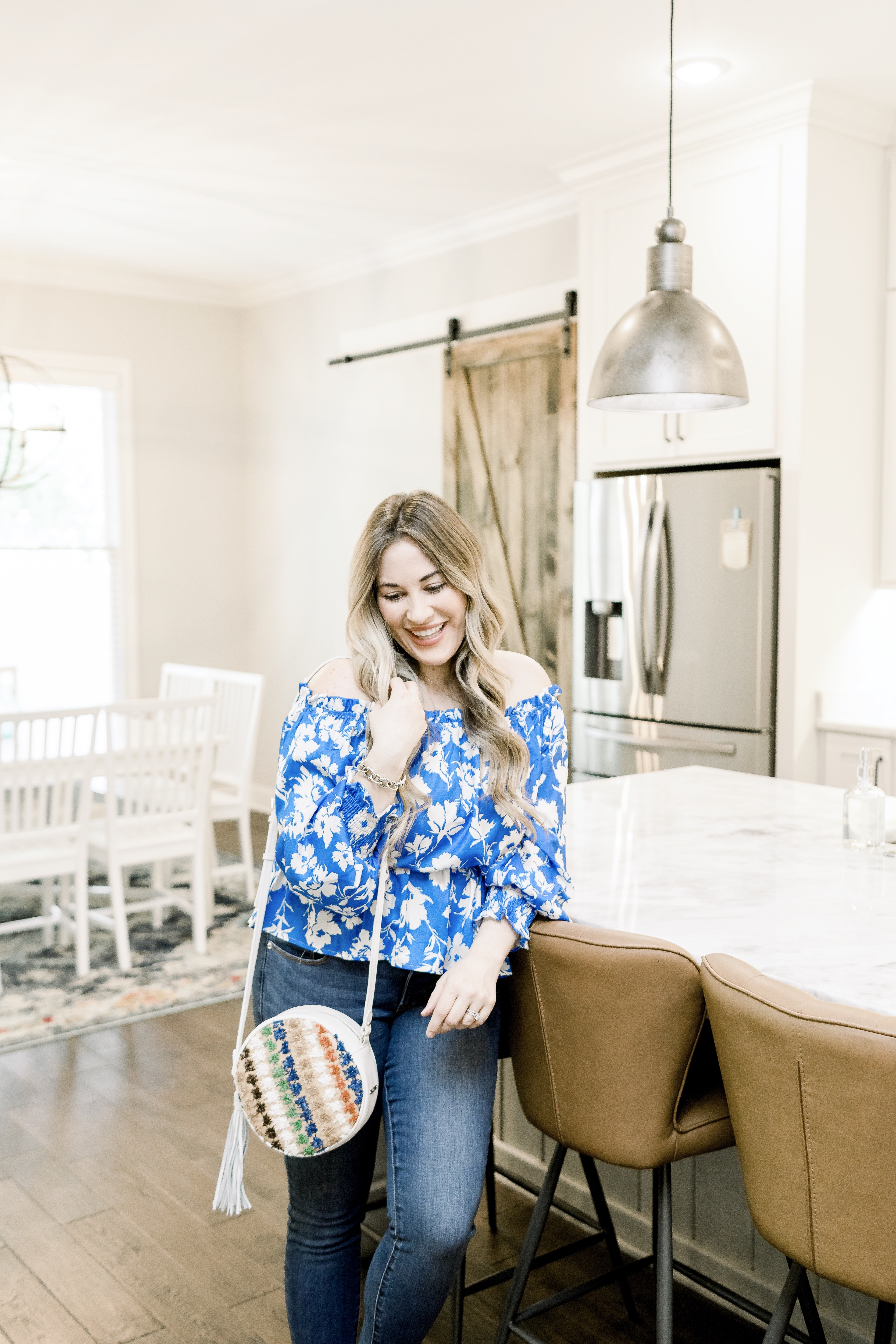 Spring denim styled by top Memphis fashion blog, Walking in Memphis in High Heels: image of a woman wearing LOFT curvy high waist jeans.