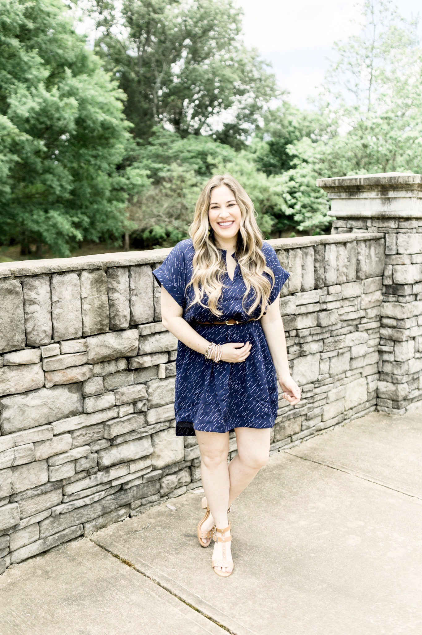 Cute Summer Dresses and Rompers featured by top Memphis fashion blog, Walking in Memphis in High Heels: image of a woman wearing a Loyal Hana polka dot maternity dress
