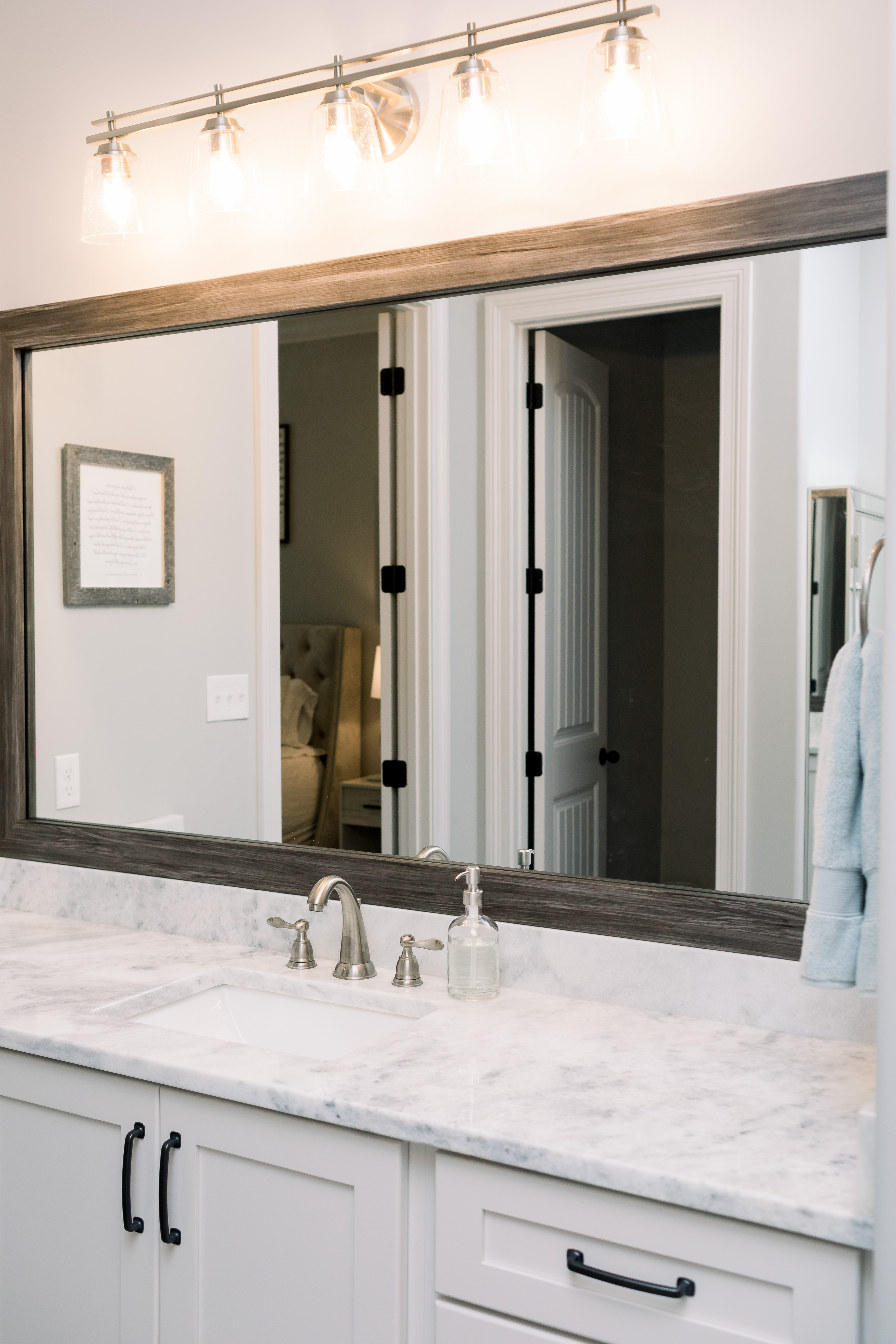 How to Update Bathroom Mirrors on a Budget, tips featured by top Memphis lifestyle blogger, Walking in Memphis in High Heels.