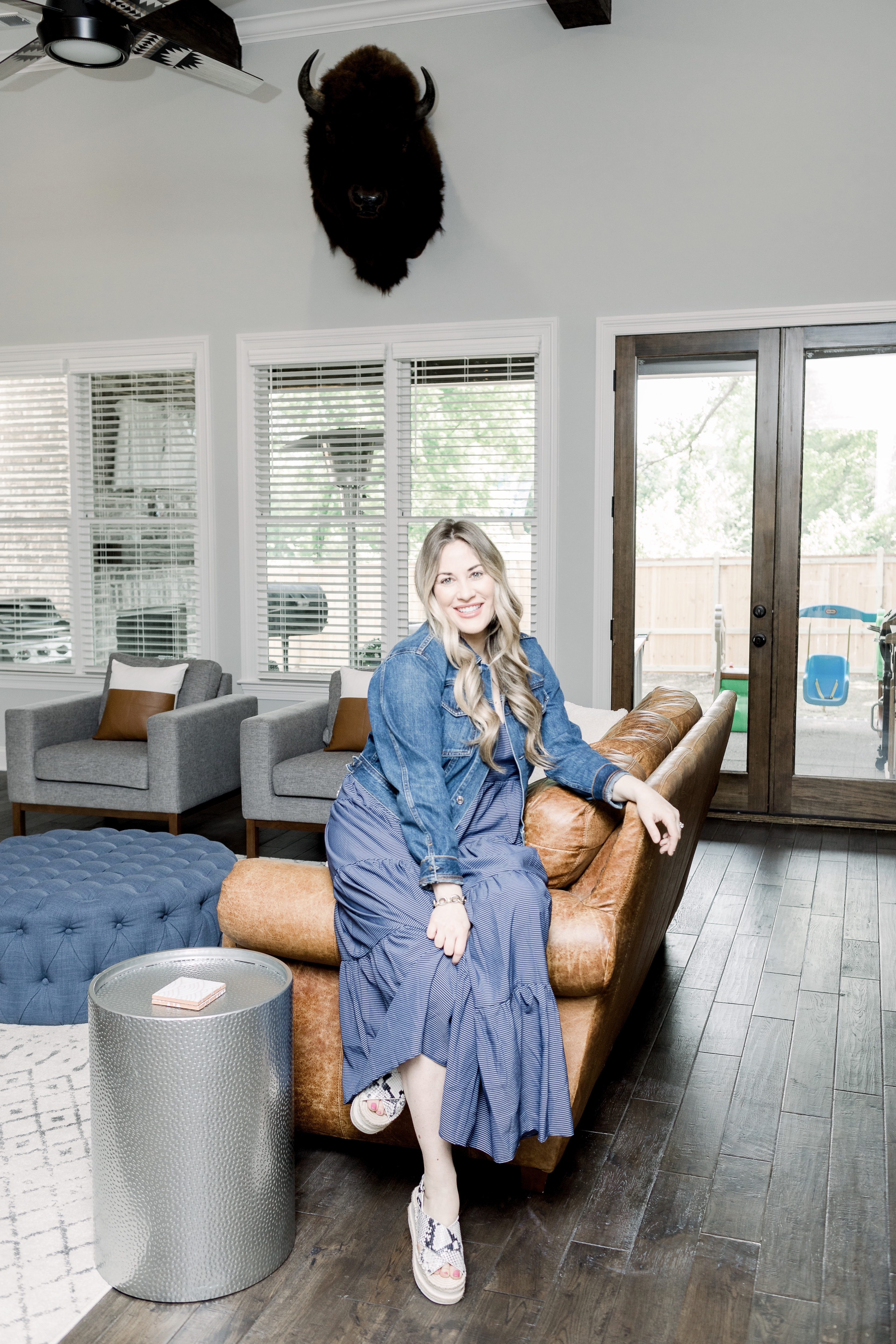 Mother's Day outfits featured by top Memphis fashion blog, Walking in Memphis in High Heels: image of a woman wearing Loyal Hana maternity dress, Everlane denim jacket and  Marc Fisher espadrille sandals.