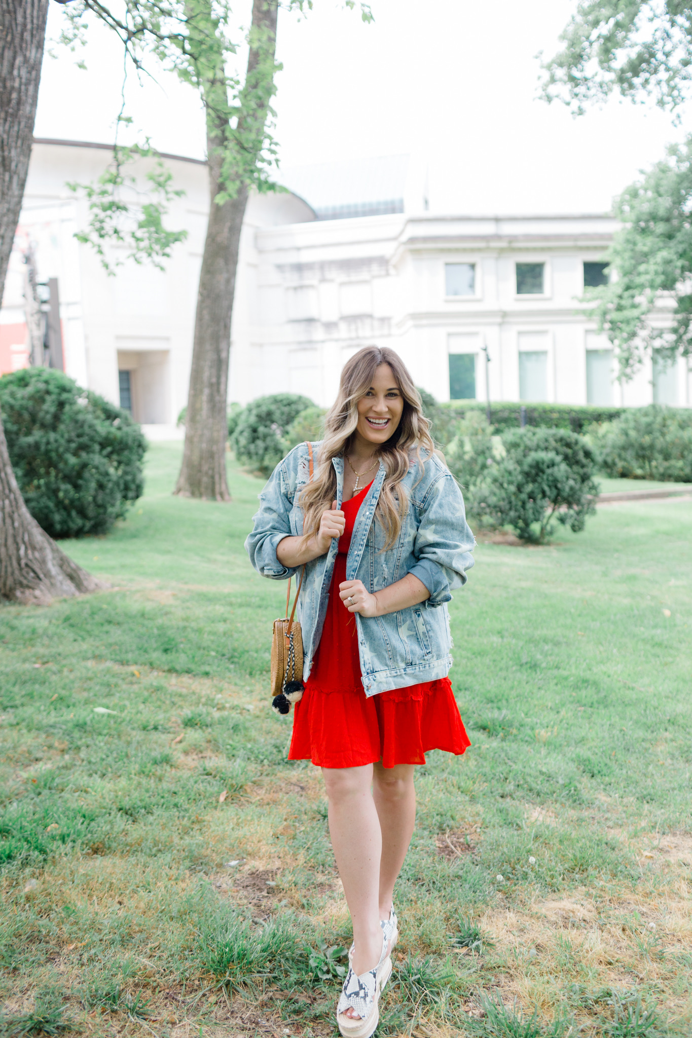 Patriotic Apparel featured by top Memphis fashion blogger, Walking in Memphis in High Heels: image of a pregnant woman wearing a North & Main red dress, North & Main star denim jacket, snake print espadrille wedge sandals, and a Baublebar initial pendant.