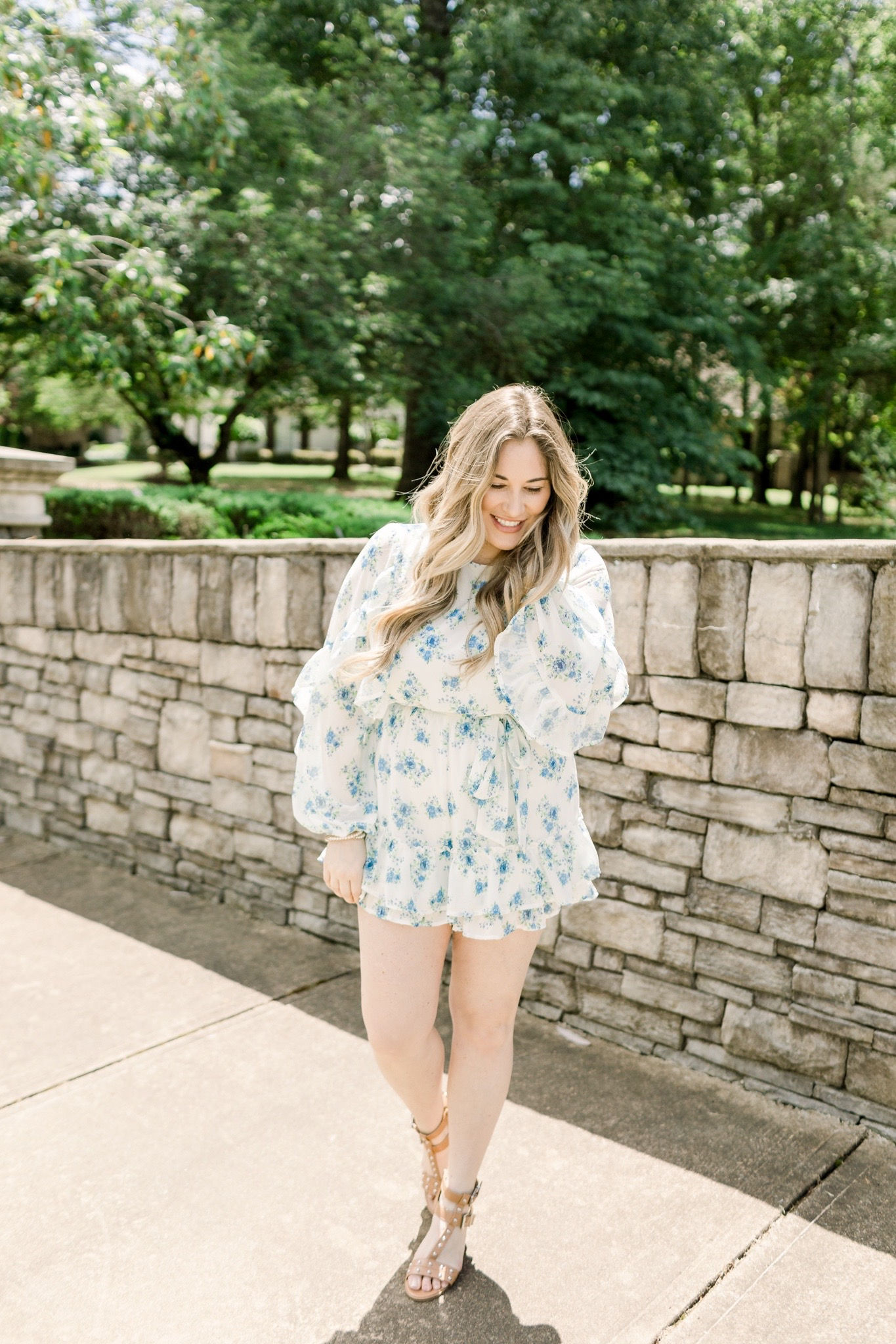 Floral romper styled for summer by top Memphis fashion blogger, Walking in Memphis in High Heels: image of a woman wearing a Red Dress Boutique Floral Romper.