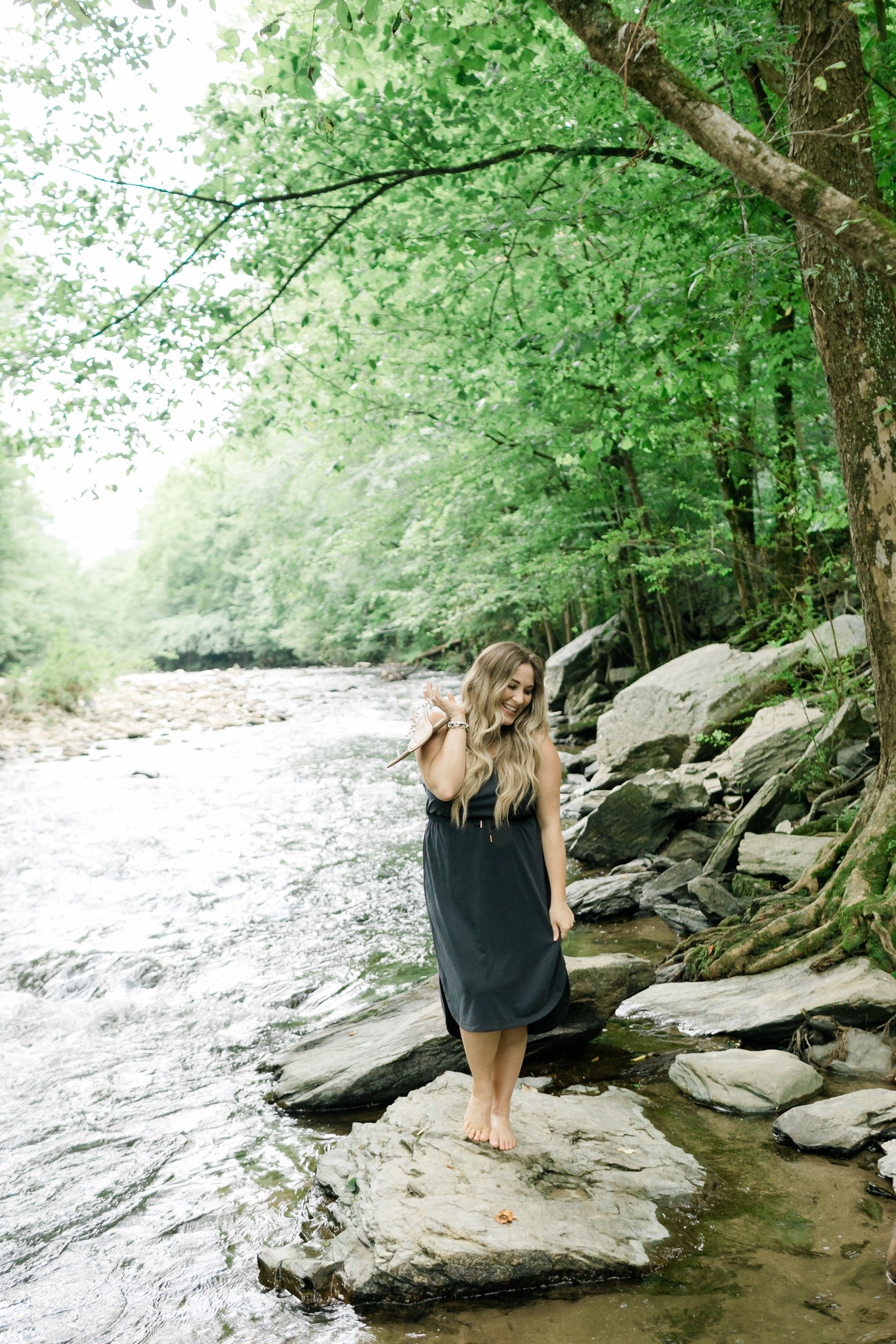 comfy casual summer outfits styled by top Memphis fashion blogger, Walking in Memphis in High Heels: image of a woman wearing an Old Navy sleeveless dress and Steve Madden clear sandals.