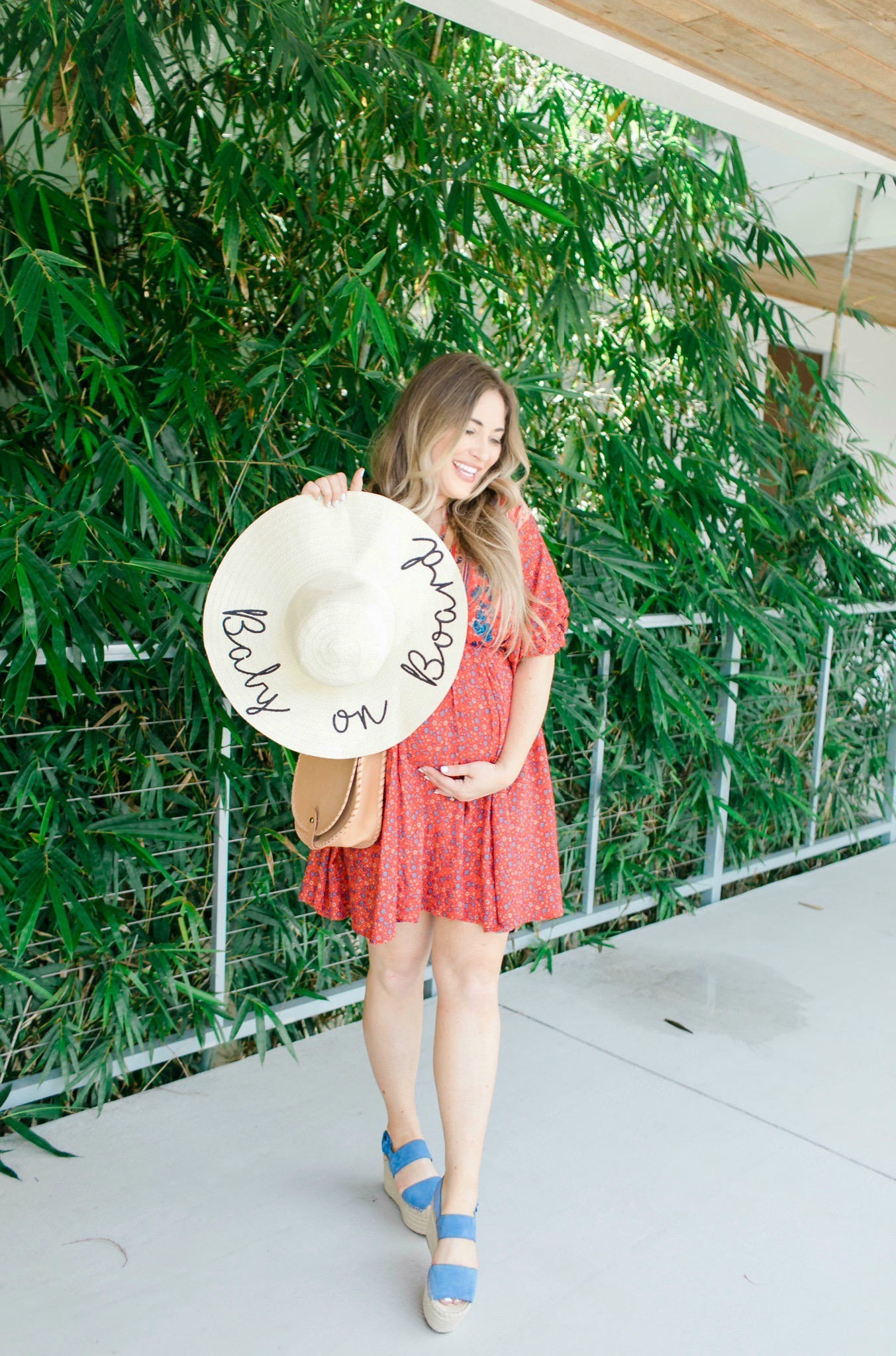 Labor Day looks featured by top Memphis fashion blogger, Walking in Memphis in High Heels: image of a woman wearing a Red Dress Boutique dress, Marc Fisher blue espadrille wedges, and a Pink Lily floppy hat.