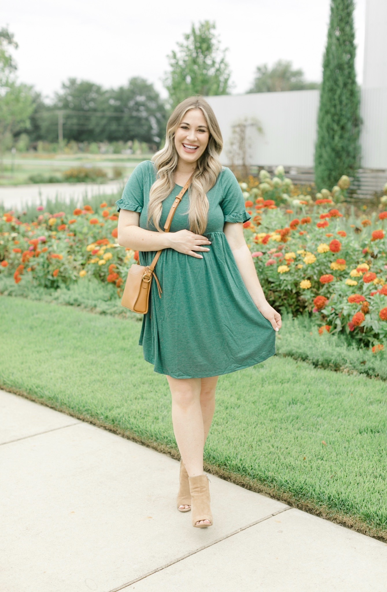Fall style featured by top Memphis fashion blogger, Walking in Memphis in High Heels: image of a women wearing a Romwe maternity dress, Vince Camuto booties, and Gigi newYork Whitney Crossbody.
