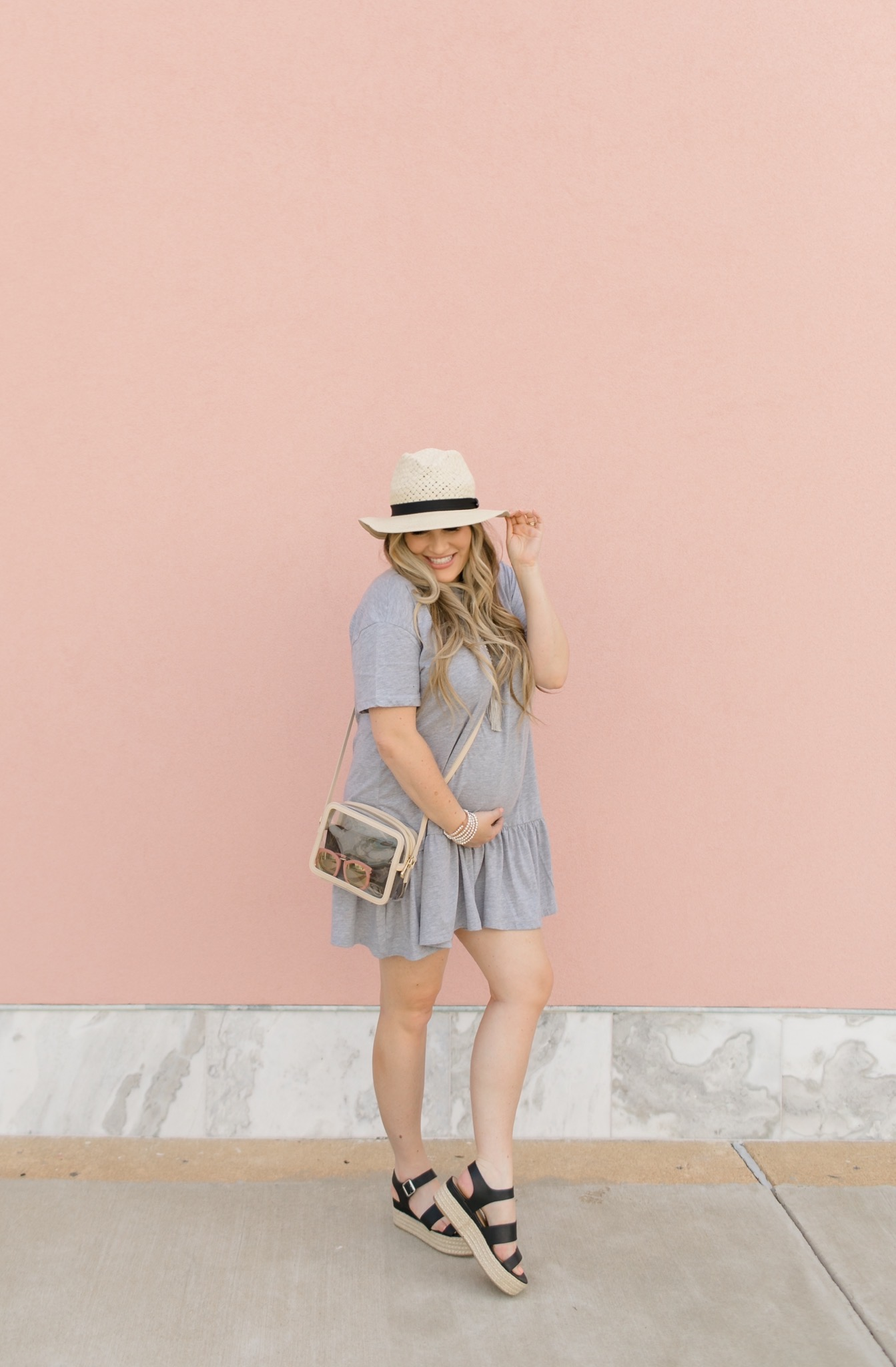 Casual maternity look feature dby top Memphis fashion blogger, Walking in Memphis in High Heels: image of a pregnant woman wearing a Nasty Gal striped tee shirt mini dress, Valett strap sandals, and a Gigi NewYork Collins Crossbody