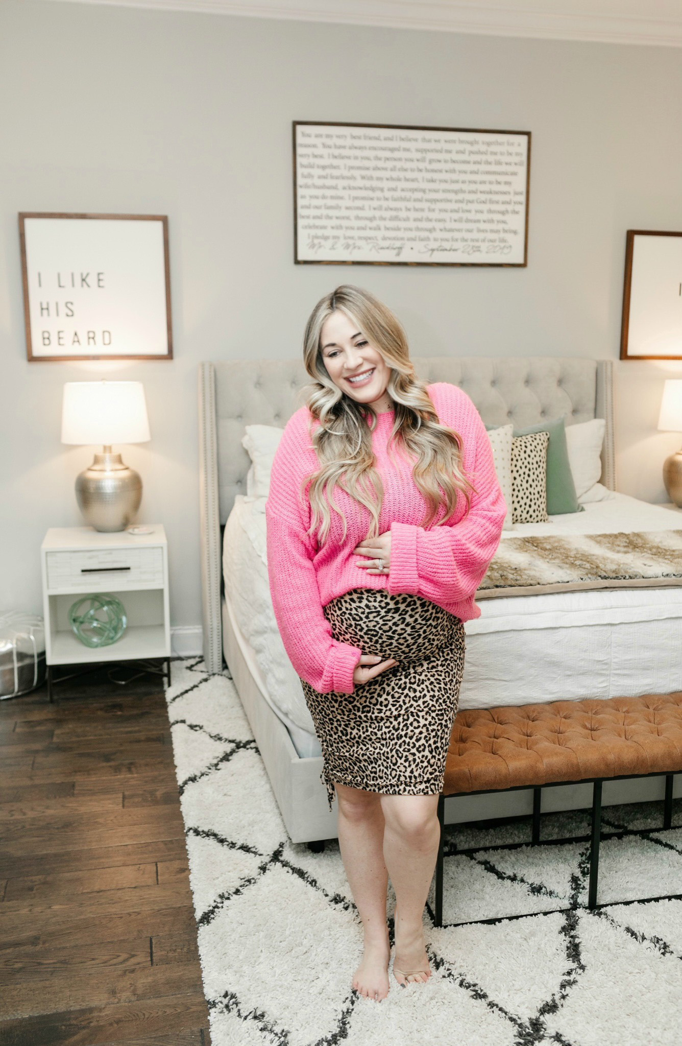 Fall maternity look featured by top Memphis fashion blogger, Walking iN Memphis in High Heels: image of a pregnant woman wearing a Stowaway Collection leopard print maternity skirt, and a FOREVER21 pink sweater