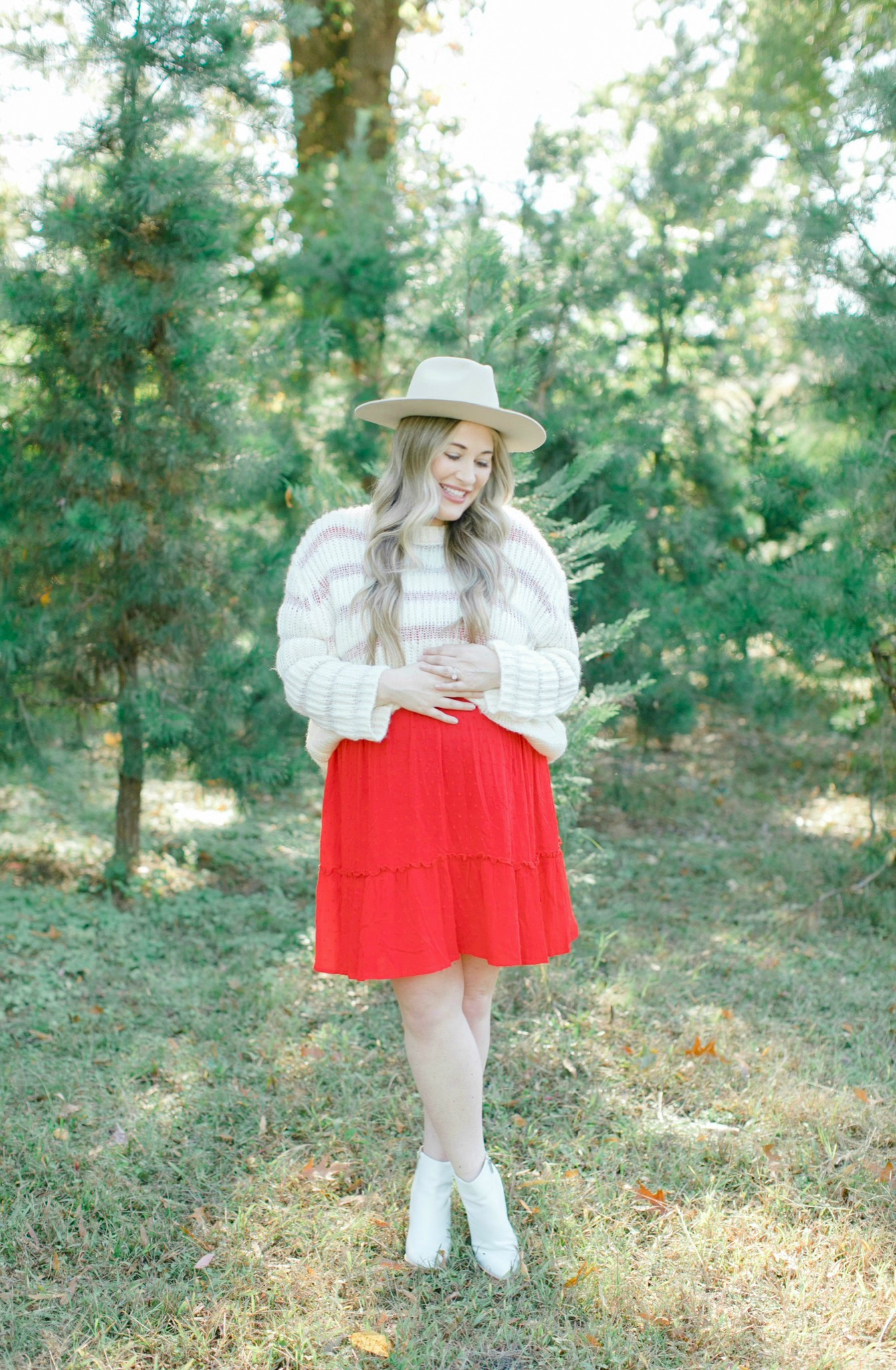 Cute Christmas Look featured by top Memphis fashion blogger, Walking in Memphis in High Heels: image of a pregnant woman wearing a Mint Julep red sing dress, Lulus knit sweater, Brixton hat and Marc Fisher white booties.