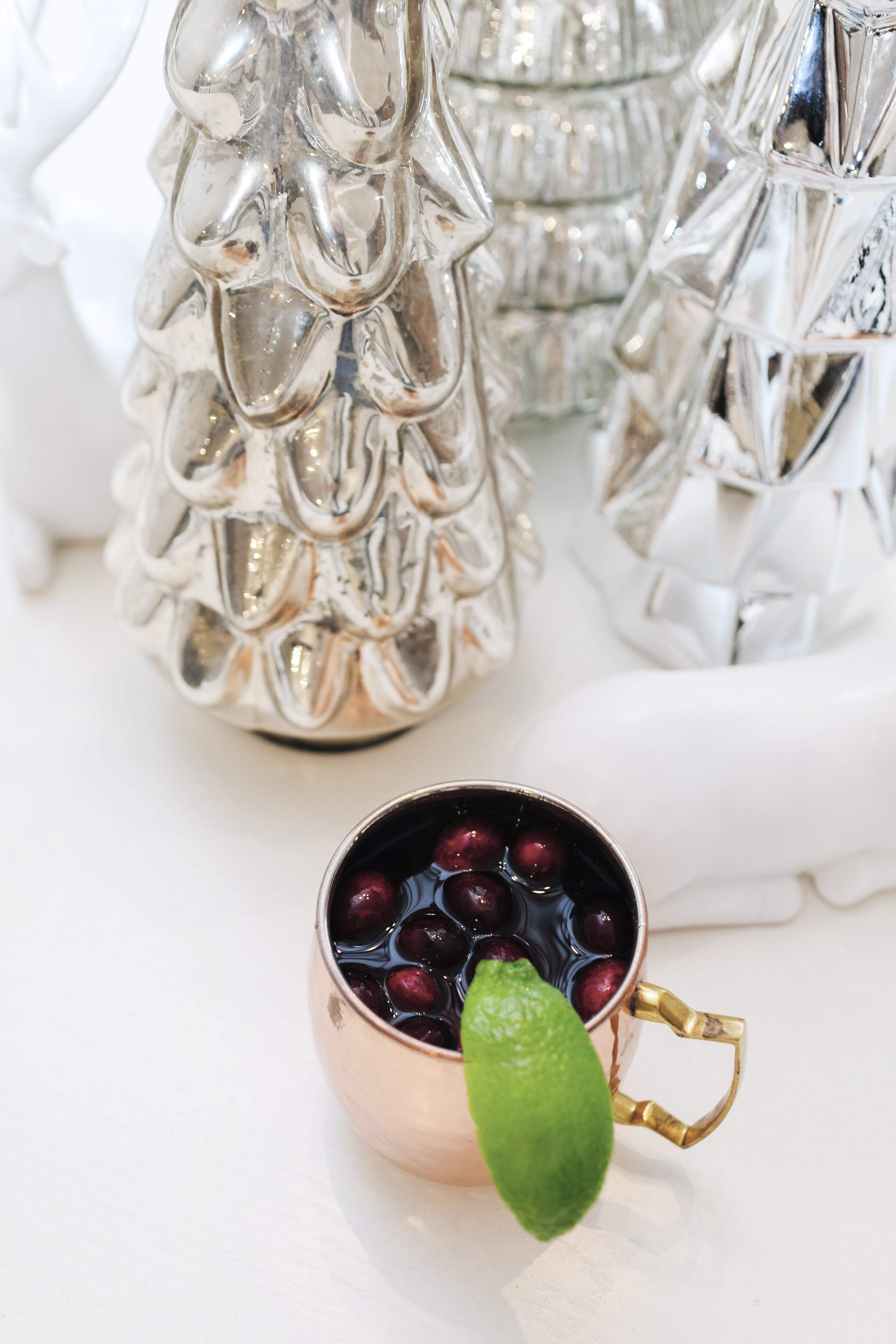Holiday Cocktail: Cranberry Moscow Mule Recipe featured by top Memphis lifestyle blogger, Walking in Memphis in High Heels.