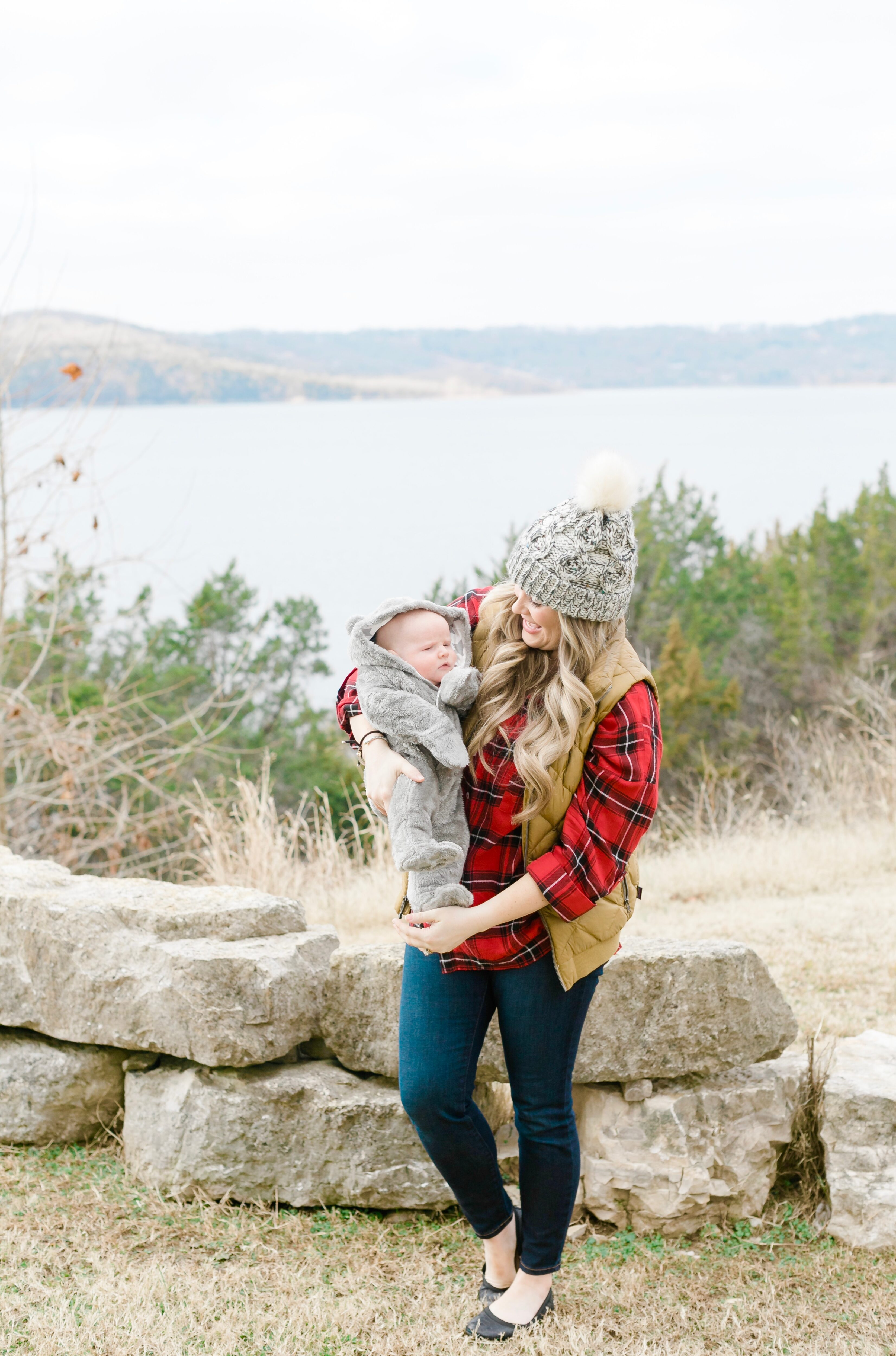 Cute beanies for women featured by top Memphis fashion blogger, Walking in Memphis in High Heels, image of a woman wearing an Altar'd State pom beanie