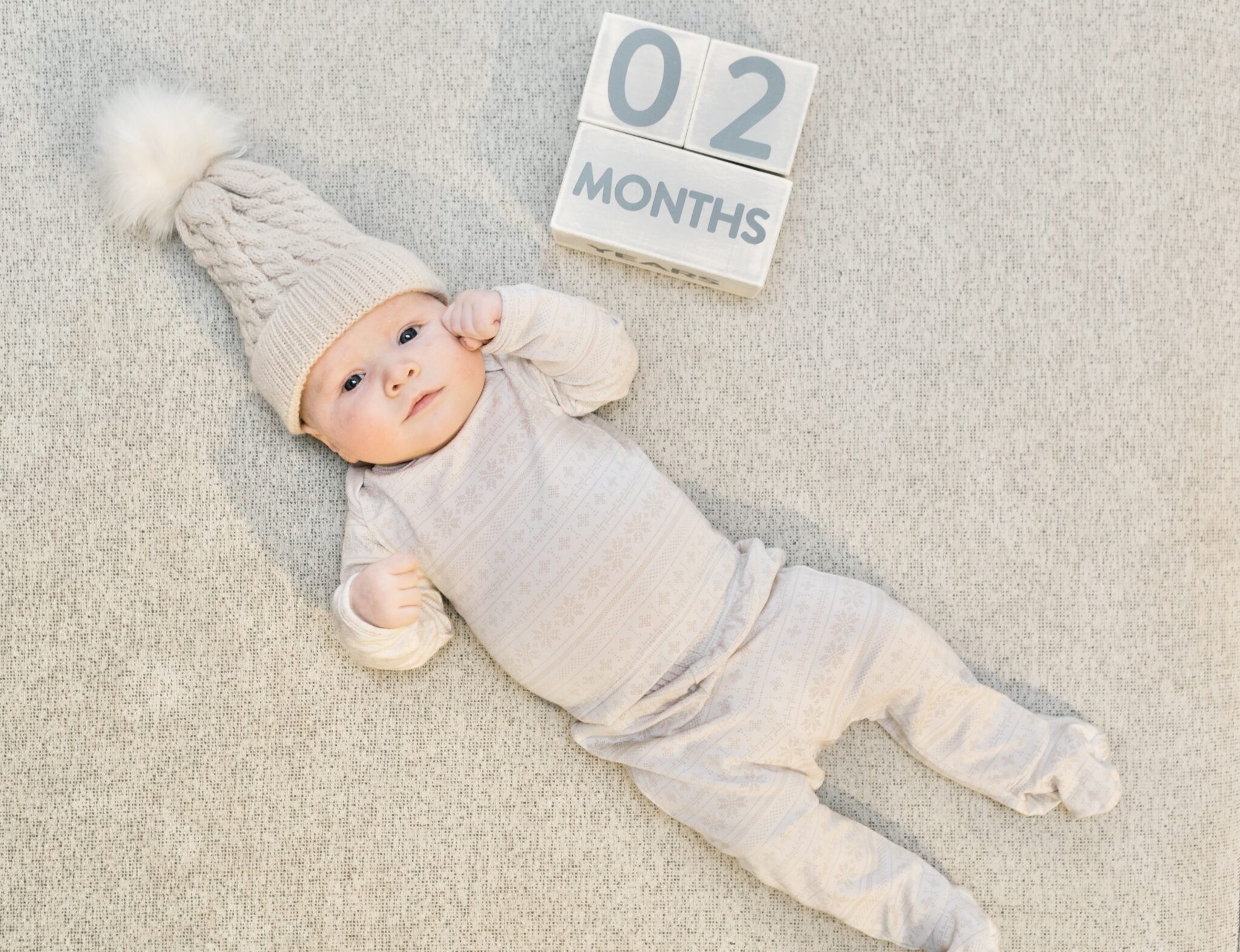 2 Month Old Baby Boy Update shared by top Memphis mommy blogger, Walking in Memphis in High Heels.